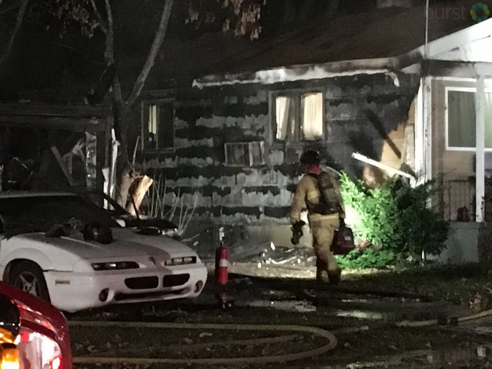 Fire damaged two Flint homes and a vehicle Tuesday night.{ }(Photo: WEYI/WSMH)