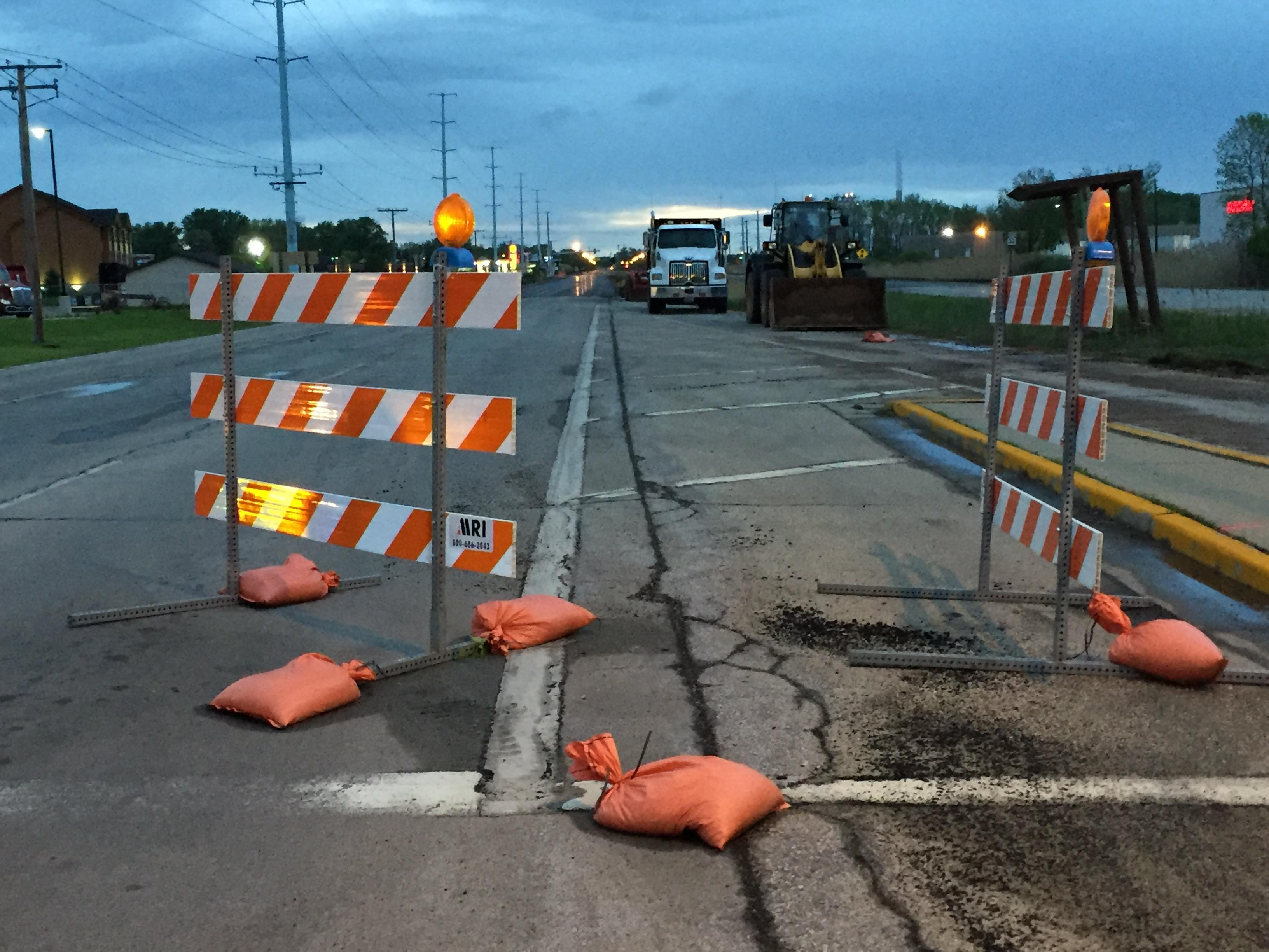 Meteorologist Katy Kramer was in the FOX 11 Storm Chaser Thursday morning, checking out the storm damage in our area. Mike McCarthy Way & Ashland Ave Construction barricades are seen blown over, tossed and damaged. (WLUK/Katy Kramer). May 18, 2017.