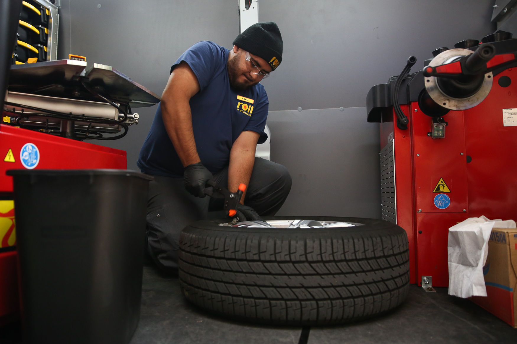The opening festivities included a tire replacement for Lauren Oshie's friend. Fred Thomas, Vice President North America Retail, says the new model seems to have struck a chord with millennials, especially women, but it's really for anyone with a busy schedule. (Amanda Andrade-Rhoades/DC Refined)