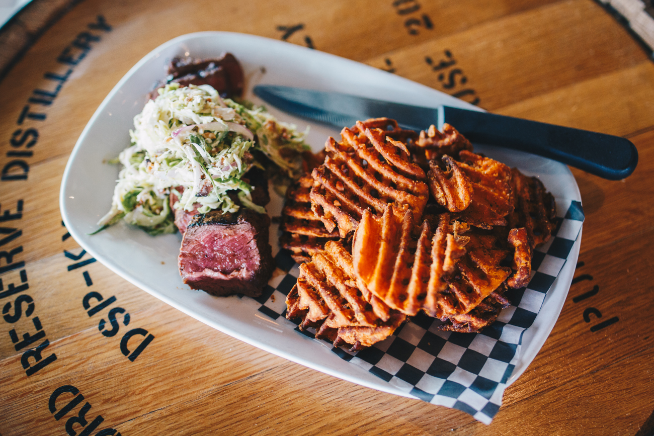 Charbroiled sirloin with shaved brussel sprout-bacon-shallot salad and sweet potato waffle fries / Image: Catherine Viox // Published: 10.17.18