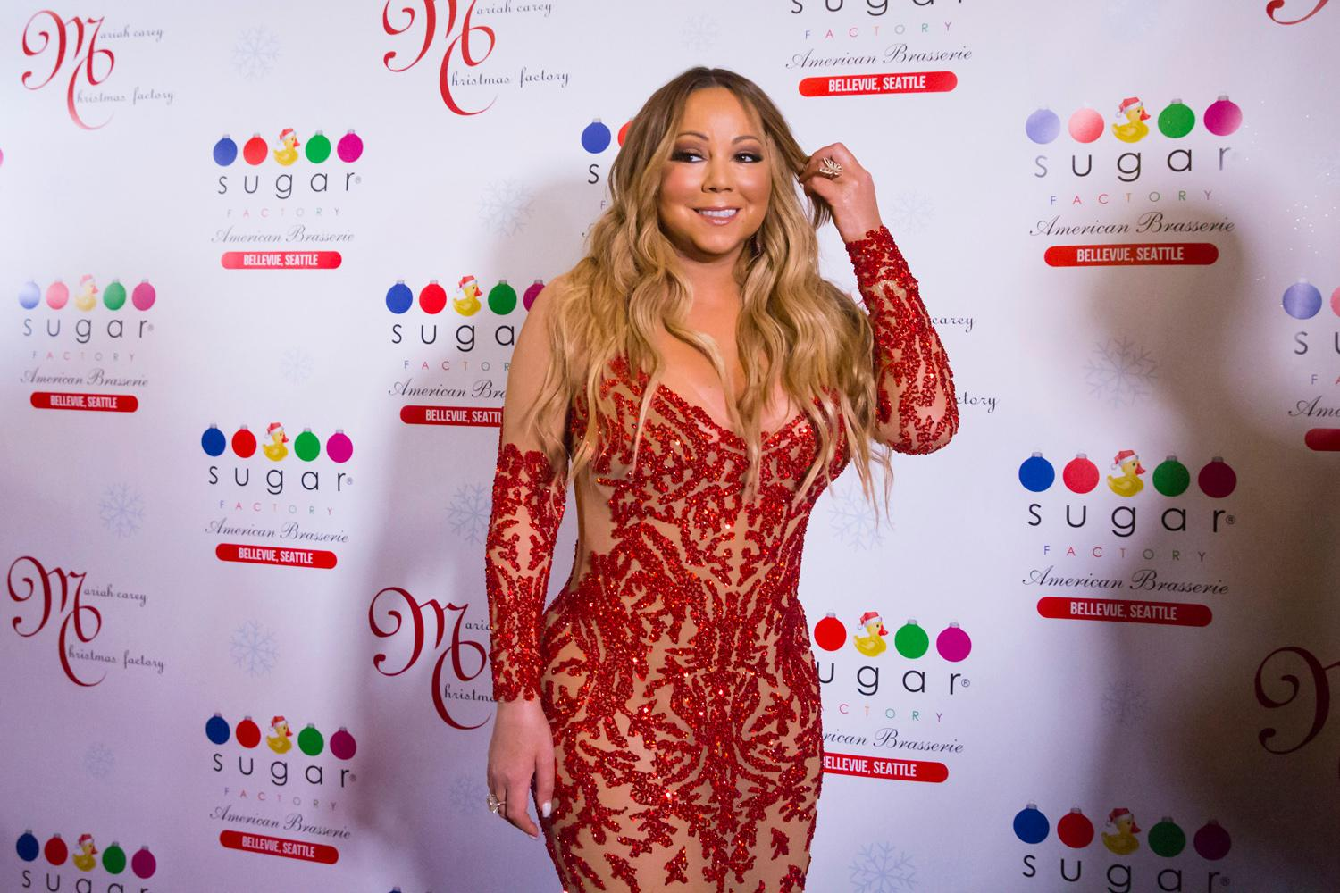 The Queen Diva herself, Ms. Mariah Carey, was on-hand at Sugar Factory in Bellevue last night (September 6, 2017), to debut her new Christmas-themed candy line for the company. Carey is in town as part of her tour with Lionel Ritchie - they played the KeyArena earlier in the week. Mariah Carey Christmas Factory will feature a Christmas themed retail and candy line, curated by Mariah, herself. Mariah Carey Christmas Factory sneak peek items will be available for sale in Seattle starting Wednesday, September 6 and available for purchase online by the end of September. The entire line of more than 100 retail and candy items including t-shirts and other custom products will be available across retail stores nationwide starting November 1, just in time for the holidays. (Sy Bean / Seattle Refined)