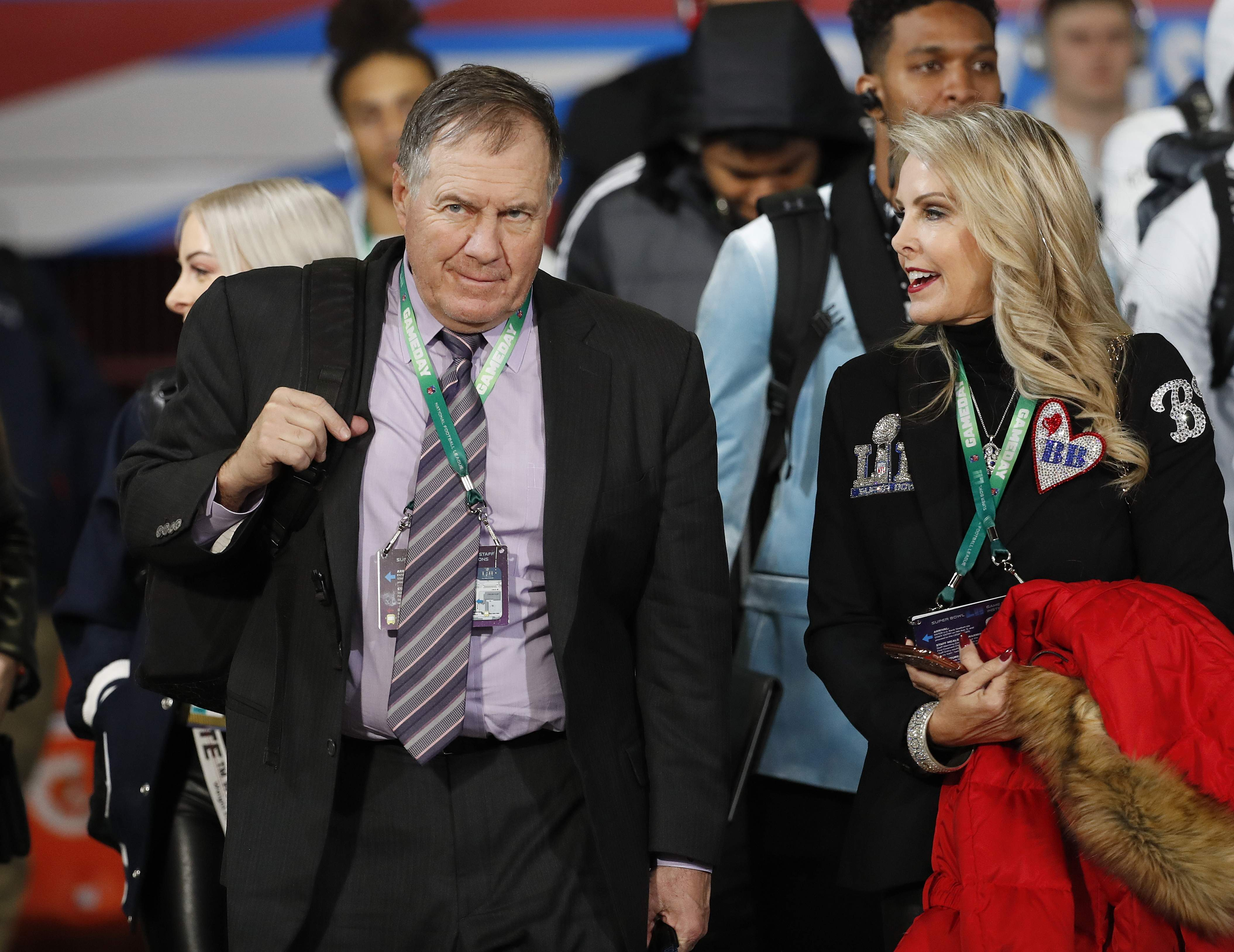 New England Patriots head coach Bill Belichick, left, and girlfriend Linda Holliday arrive before the NFL Super Bowl 52 football game against the Philadelphia Eagles Sunday, Feb. 4, 2018, in Minneapolis. (AP Photo/Matt York)