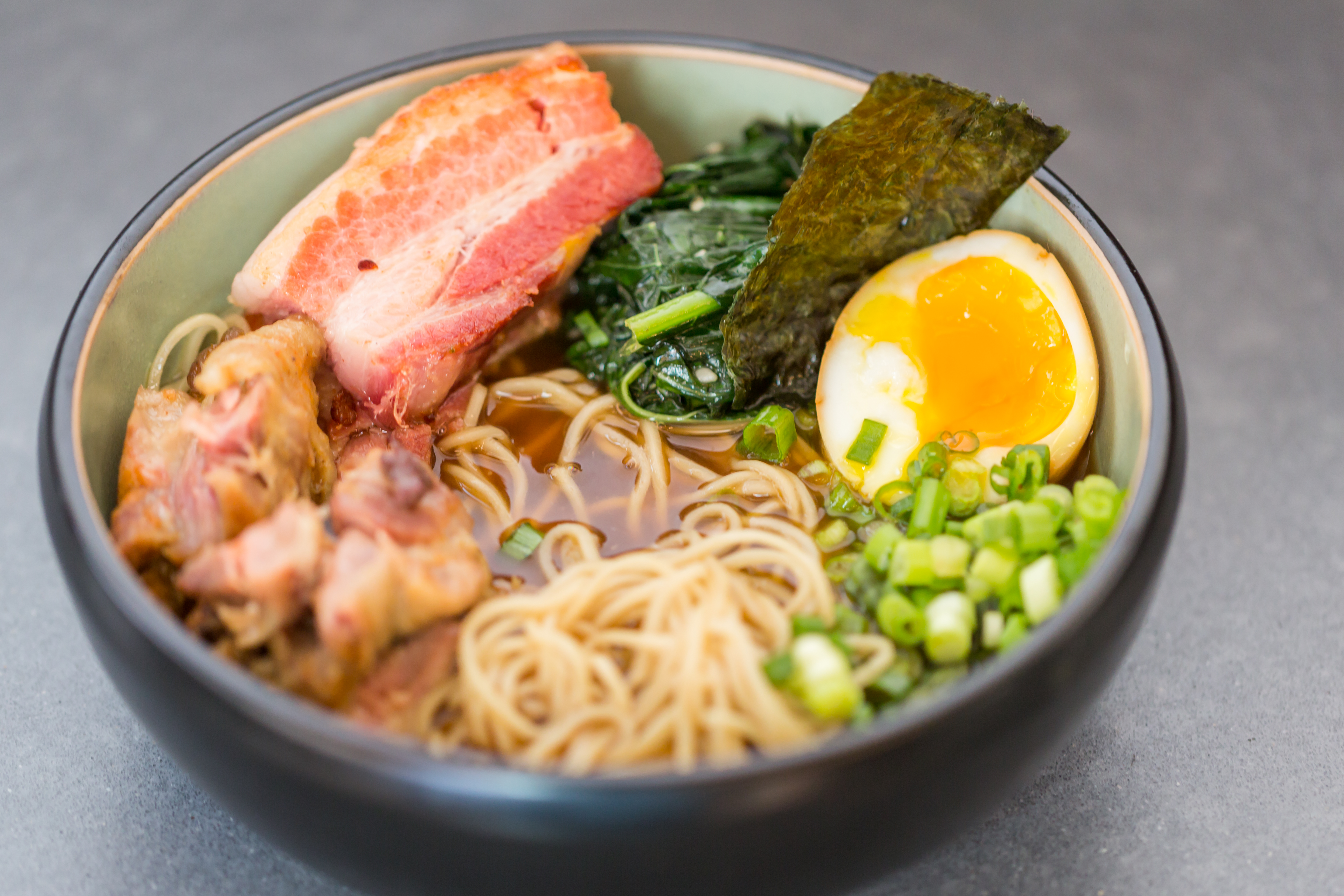 <p>Ramen: braised pork, spinach, soft egg and shoyu broth (Image: Courtesy District Winery)</p>