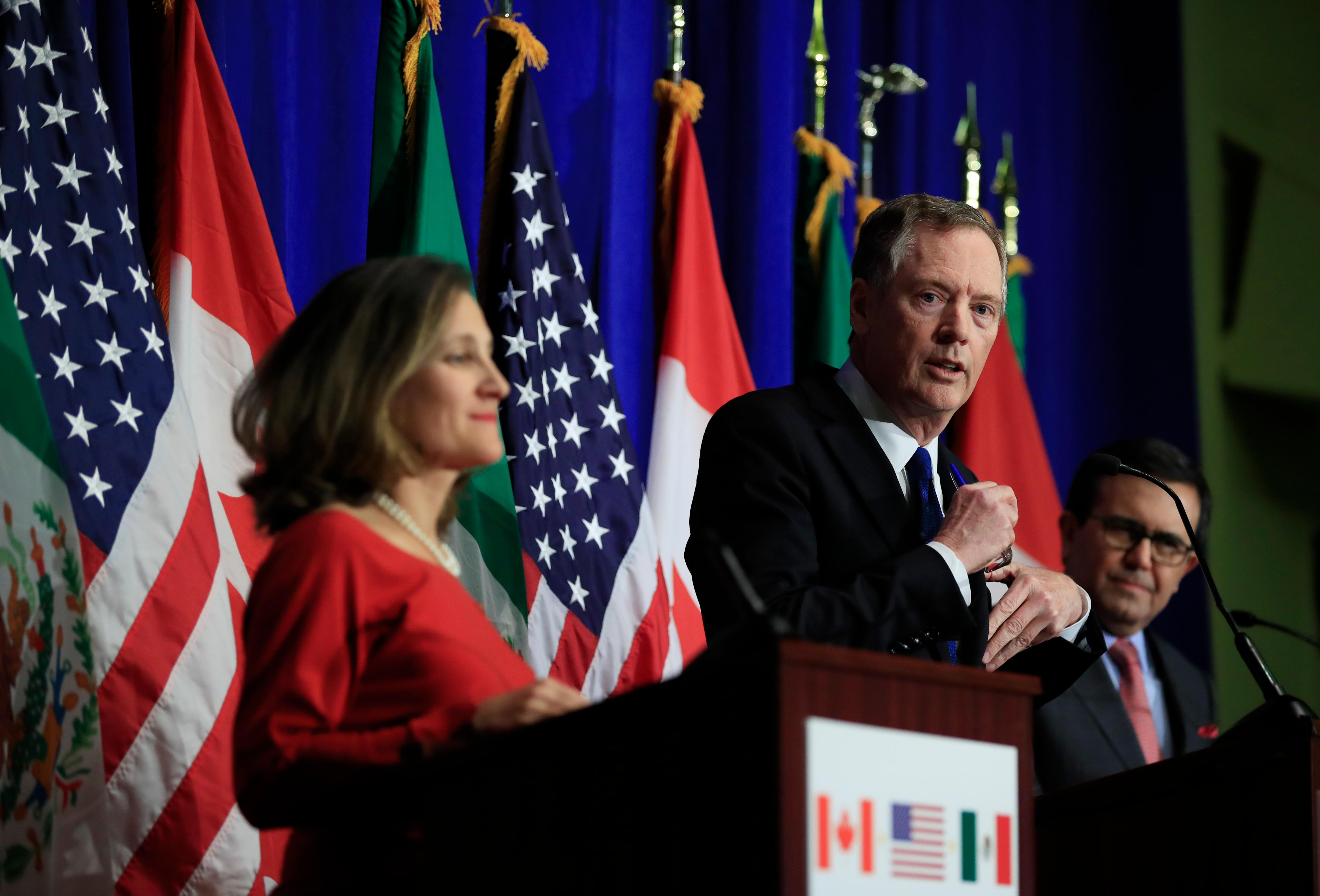 United States Trade Representative Robert Lighthizer, center, with Canadian Minister of Foreign Affairs Chrystia Freeland, left, and Mexico's Secretary of Economy Ildefonso Guajardo Villarrea, right, speaks during the conclusion of the fourth round of negotiations for a new North American Free Trade Agreement (NAFTA) in Washington, Tuesday, Oct. 17, 2017. (AP Photo/Manuel Balce Ceneta)