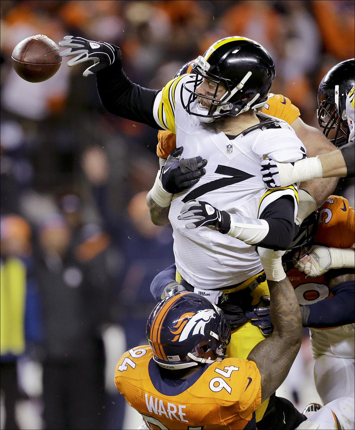 Pittsburgh Steelers quarterback Ben Roethlisberger, top, is sacked by Denver Broncos outside linebacker DeMarcus Ware, below, during the second half in an NFL football divisional playoff game, Sunday, Jan. 17, 2016, in Denver. (AP Photo/Joe Mahoney)