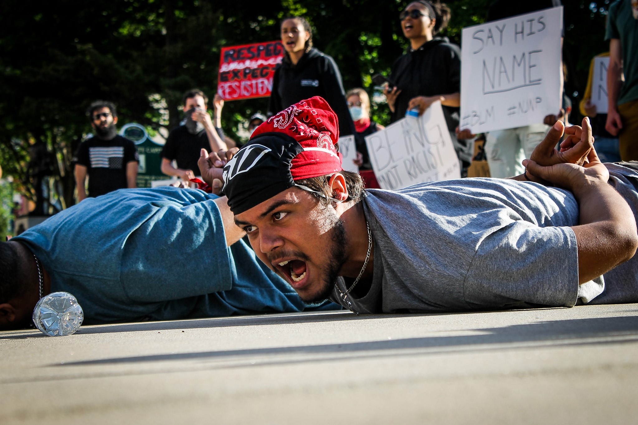 Protesters lay on the ground for nine minutes while chanting in Lansing.{&nbsp;}{&nbsp;}(WWMT/Mikenzie Frost)<p></p>