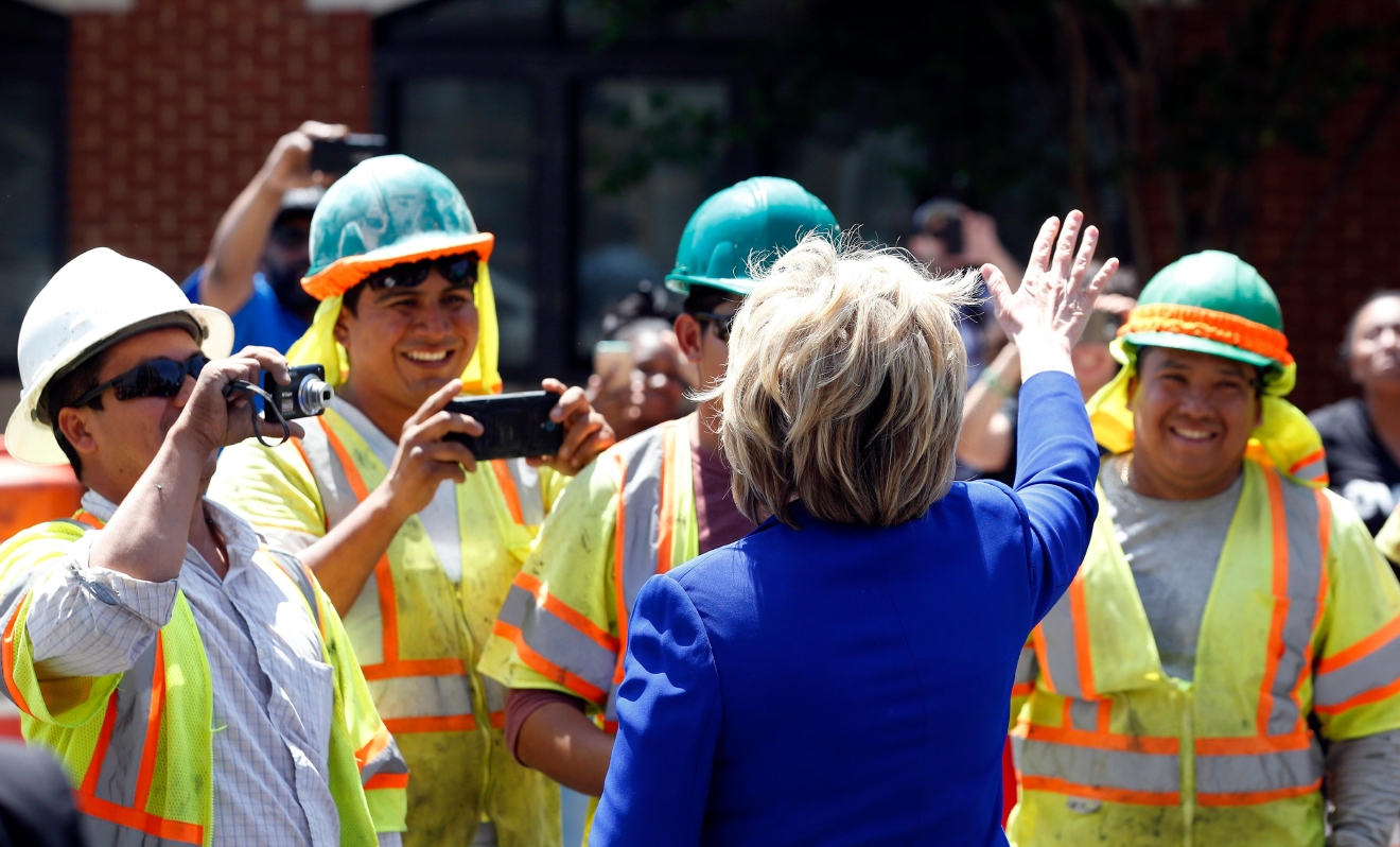 Democratic presidential candidate Hillary Clinton greets workers after a stop at Uprising Muffin Company, Friday, June 10, 2016, in Washington. (AP Photo/Alex Brandon)