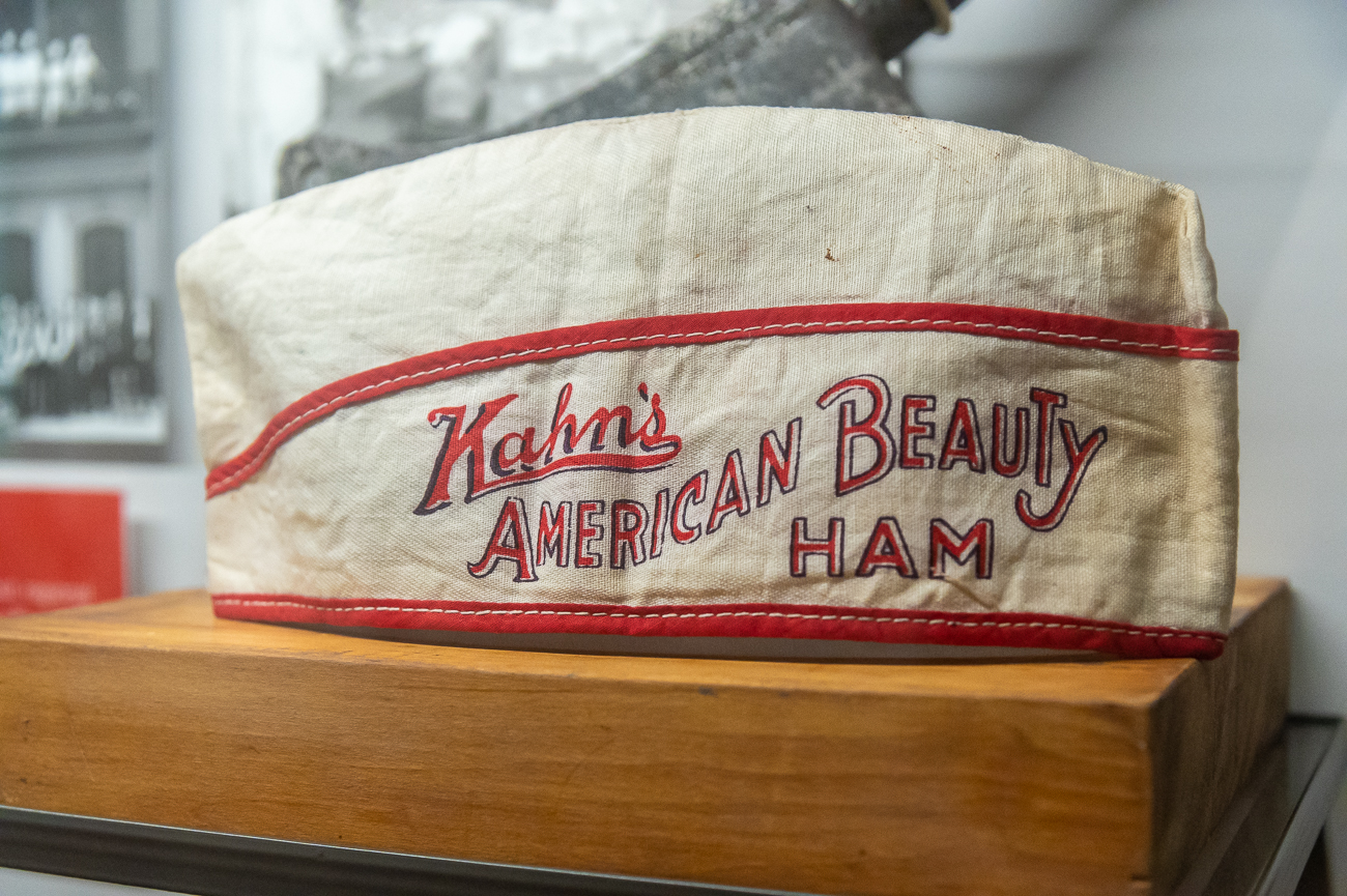 A Kahn's employee hat with a Kahn's meat cleaver behind it / Image: Phil Armstrong, Cincinnati Refined // Published: 10.23.20