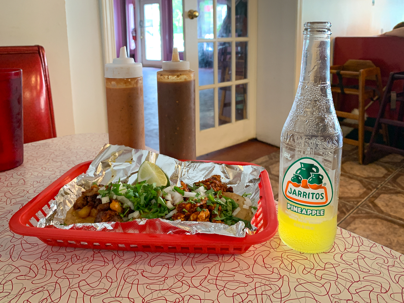 PLACE: Taqueria San Marcos / ADDRESS: 5201 Carthage Avenue (Norwood) / DESCRIPTION: When I walk into Taqueria San Marcos, I feel like I'm stepping back into a simpler time. I love the old diner décor and, of course, a fridge full of Jarritos. I had the al pastor, tripa, and chorizo tacos. All three were delicious and unique in their own right. They have plenty of meat options, from the conventional (chicken or beef) to the meat you can't get at those more well-known places (like beef tongue and beef gut). / Image: Shawn Braley // Published: 5.28.19
