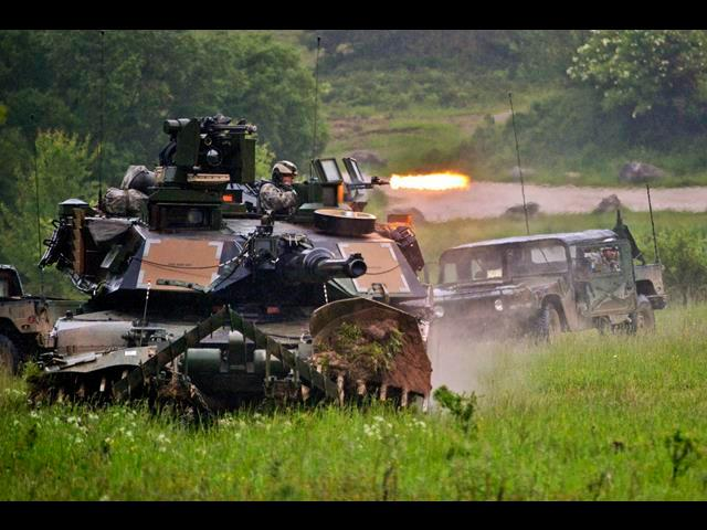U.S. soldiers in an M1A2 Abrams tank hunt for the enemy during Combined Resolve II at the Joint Multinational Readiness Center in Hohenfels, Germany, May 29, 2014.