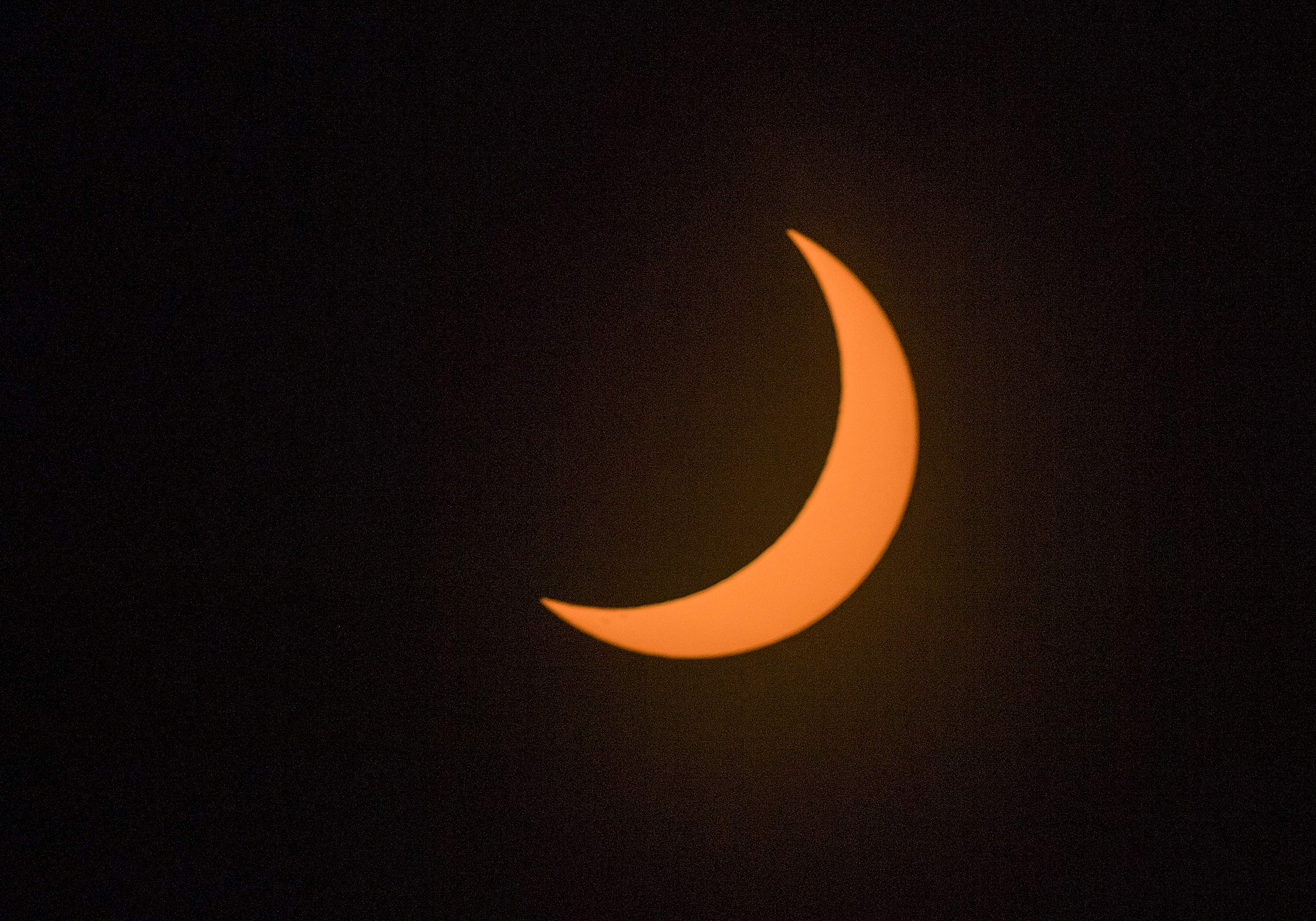 About 78% of the sun is covered by the moon at the peak of the partial eclipse over Stockton about 10:18 a.m. [CLIFFORD OTO/THE RECORD]