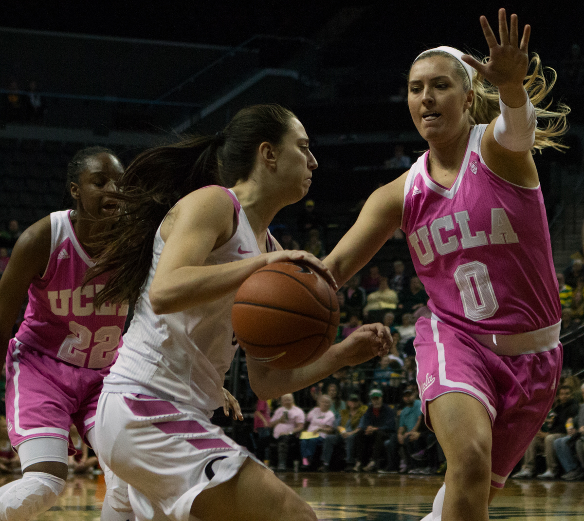 Oregon Ducks guard Maite Cazorla (#5) drives around UCLA guard Nicole Kornet (#0). The Oregon Ducks defeated the No. 15 UCLA Bruins 84-75 Friday evening at Matthew Knight Arena in Eugene, Oregon.  Photo by Duncan Moore, Oregon News Lab