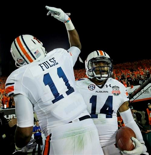 Auburn's Nick Marshall celebrates his touchdown run with Brandon Fulse during the first half of the NCAA BCS National Championship college football game against Florida State Monday, Jan. 6, 2014, in Pasadena, Calif.