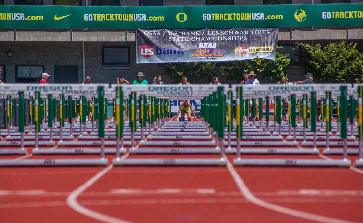 An athlete participates in the Girls 100 Meter Hurdles 6A Prelims event at the OSAA Track and Field State Championships at Hayward Field. The event was won by Deshae Wise from Grants Pass High School with the time of 14.18. Photo by Vannie Cooper, Oregon News Lab