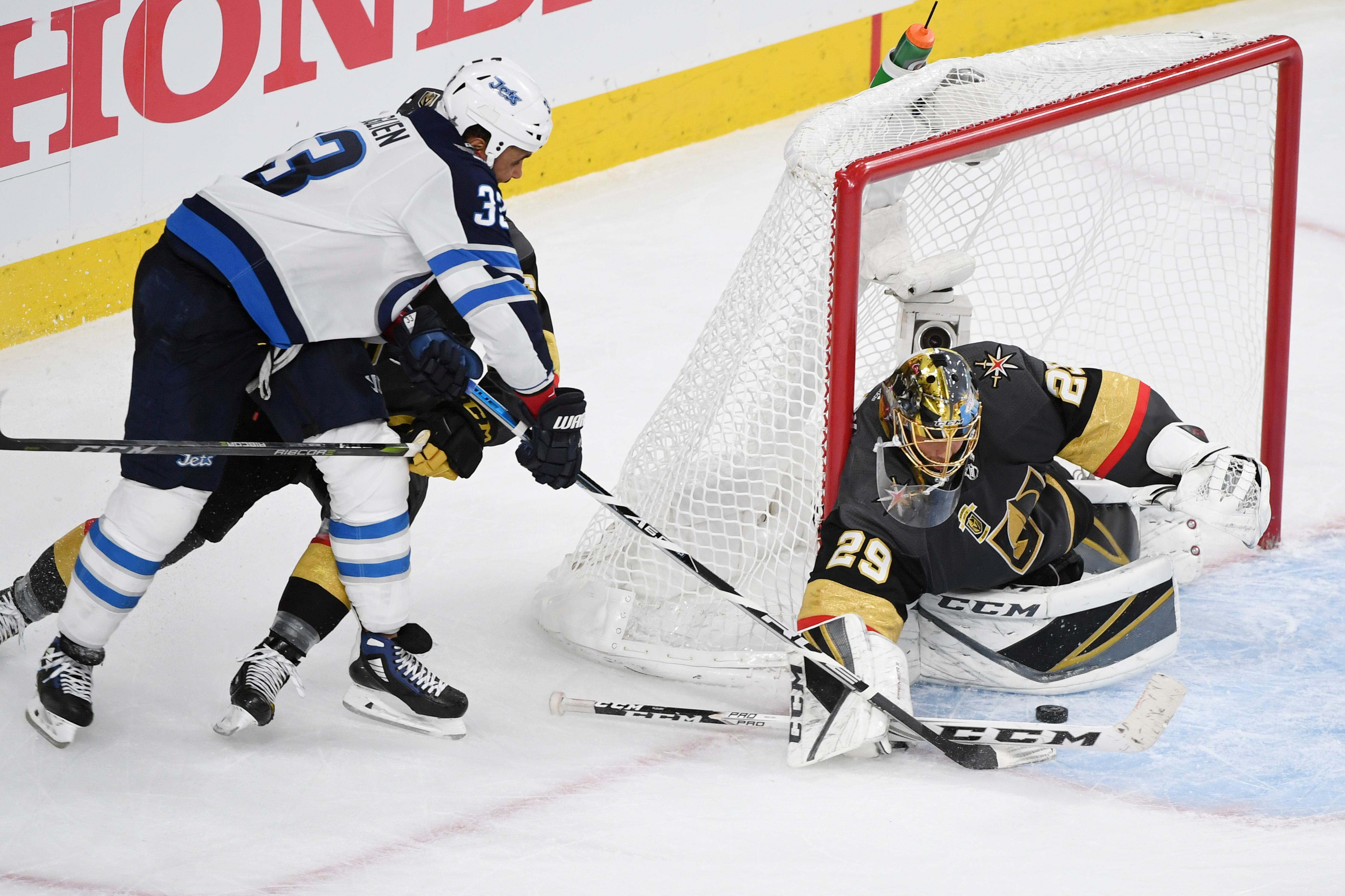 Vegas Golden Knights goaltender Marc-Andre Fleury (29) stops a wrap around shot by Winnipeg Jets defenseman Dustin Byfuglien (33) during Game 3 of their NHL hockey Western Conference Final game Wednesday, May 16, 2018, at T-Mobile Arena. The Golden Knights won 4-2 to take a 2-1 lead in the series. CREDIT: Sam Morris/Las Vegas News Bureau