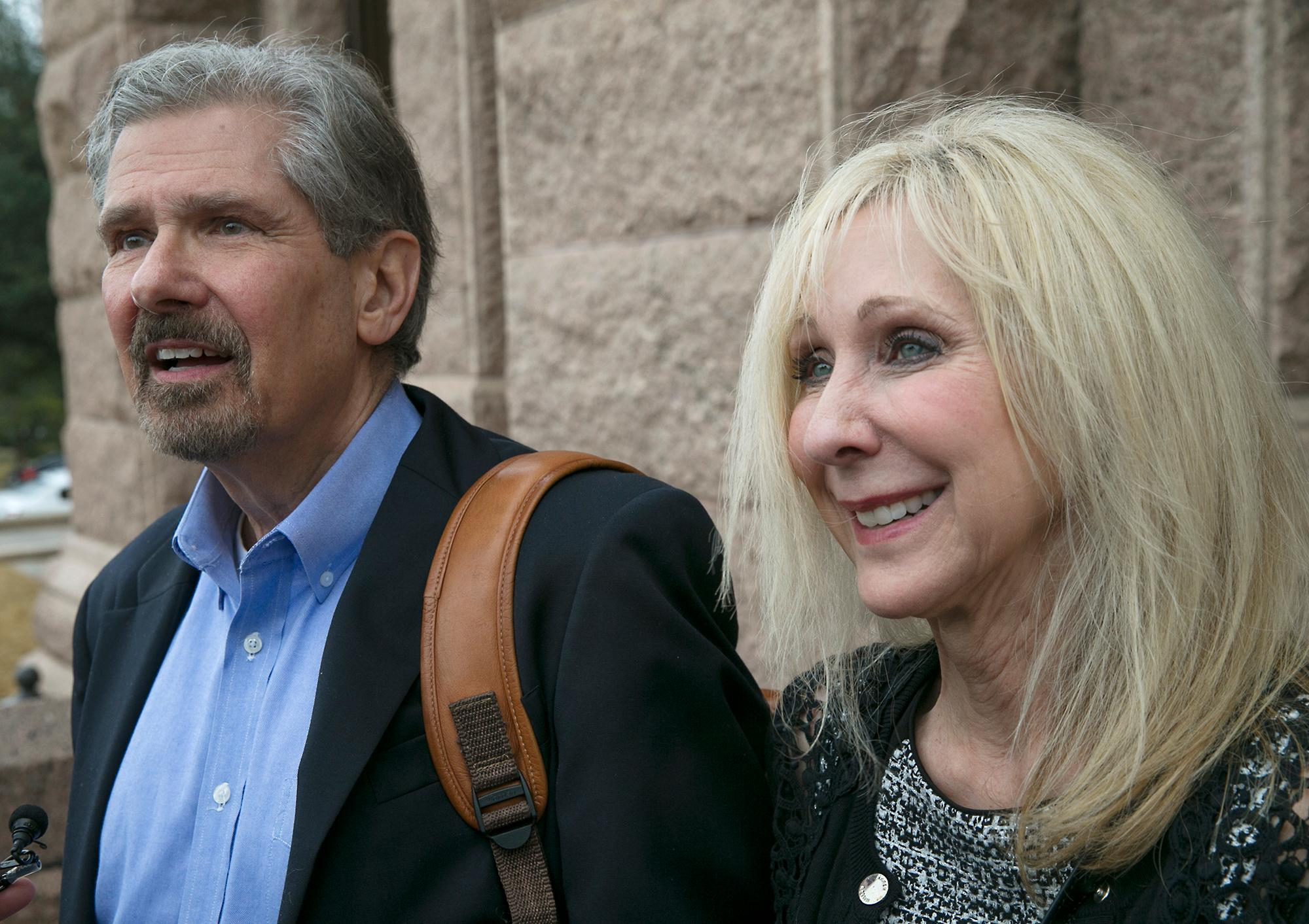 Kent Whitaker and his wife Tanya walk out of the Texas Capitol after learning the Texas Board of Pardons and Paroles voted unanimously to recommend clemency for death row inmate Thomas Whitaker, Kent's son who was found guilty of setting up an ambush that killed his mother and brother in 2003. Despite the crime, his father had waged a desperate campaign to spare his life before Thursday's scheduled execution. The board recommended that Whitaker's sentence be reduced to life in prison as they read the reaction Tuesday, Feb. 20, 2018, in Austin, Texas. (Ralph Barrera/Austin American-Statesman via AP)