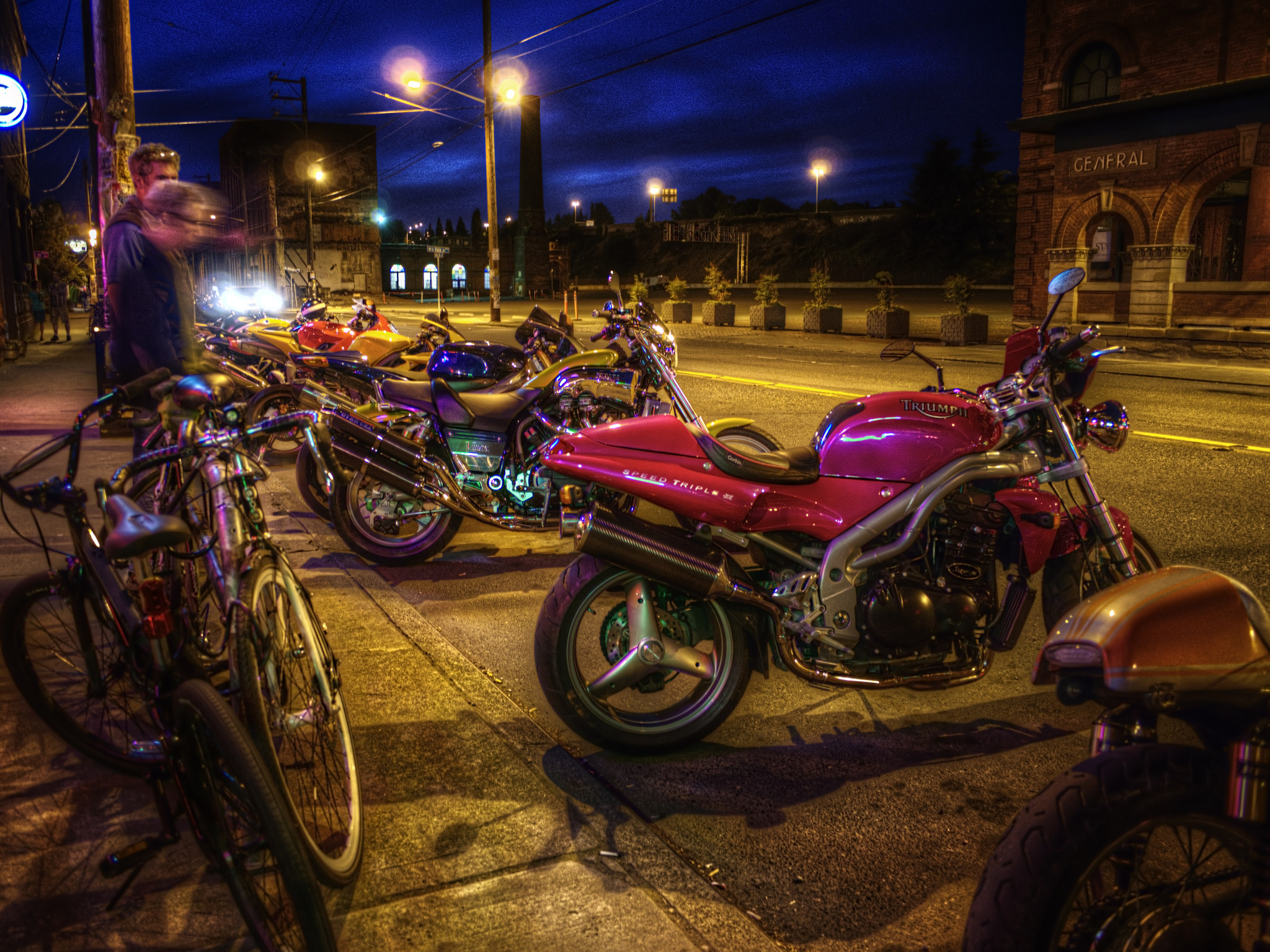 Located in Georgetown, Smarty Pants is a dive-y biker bar resplendent with bikes on display above the entrance, cheap beer, stiff drinks and the race usually on the tube. (Image: vmax137 / https://flic.kr/p/fqYrDJ)