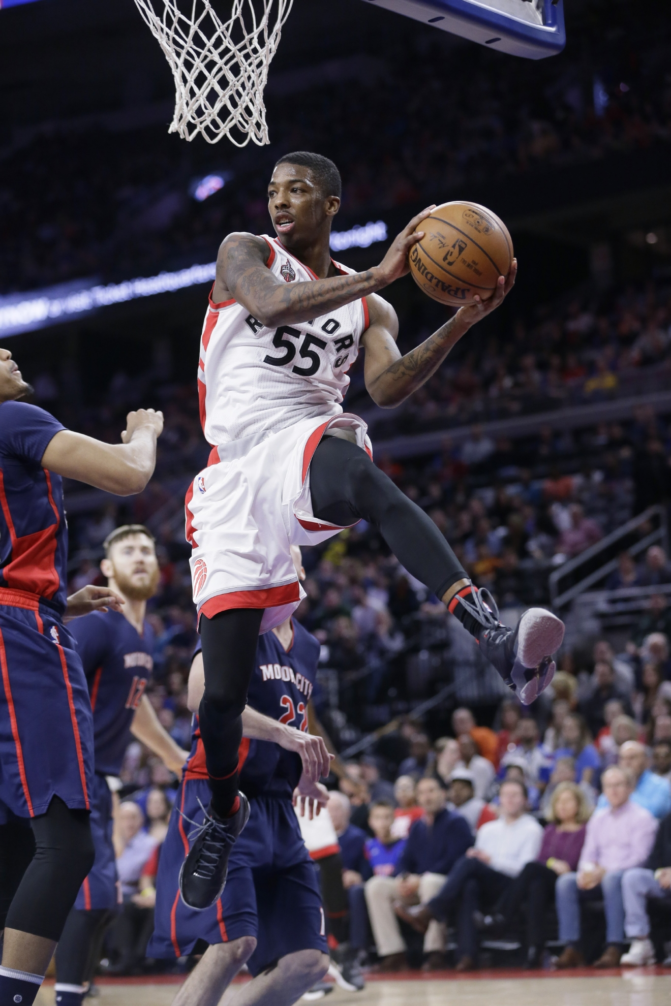 Toronto Raptors guard Delon Wright looks to pass the ball during the first half of an NBA basketball game against the Detroit Pistons, Sunday, Feb. 28, 2016, in Auburn Hills, Mich. (AP Photo/Carlos Osorio)