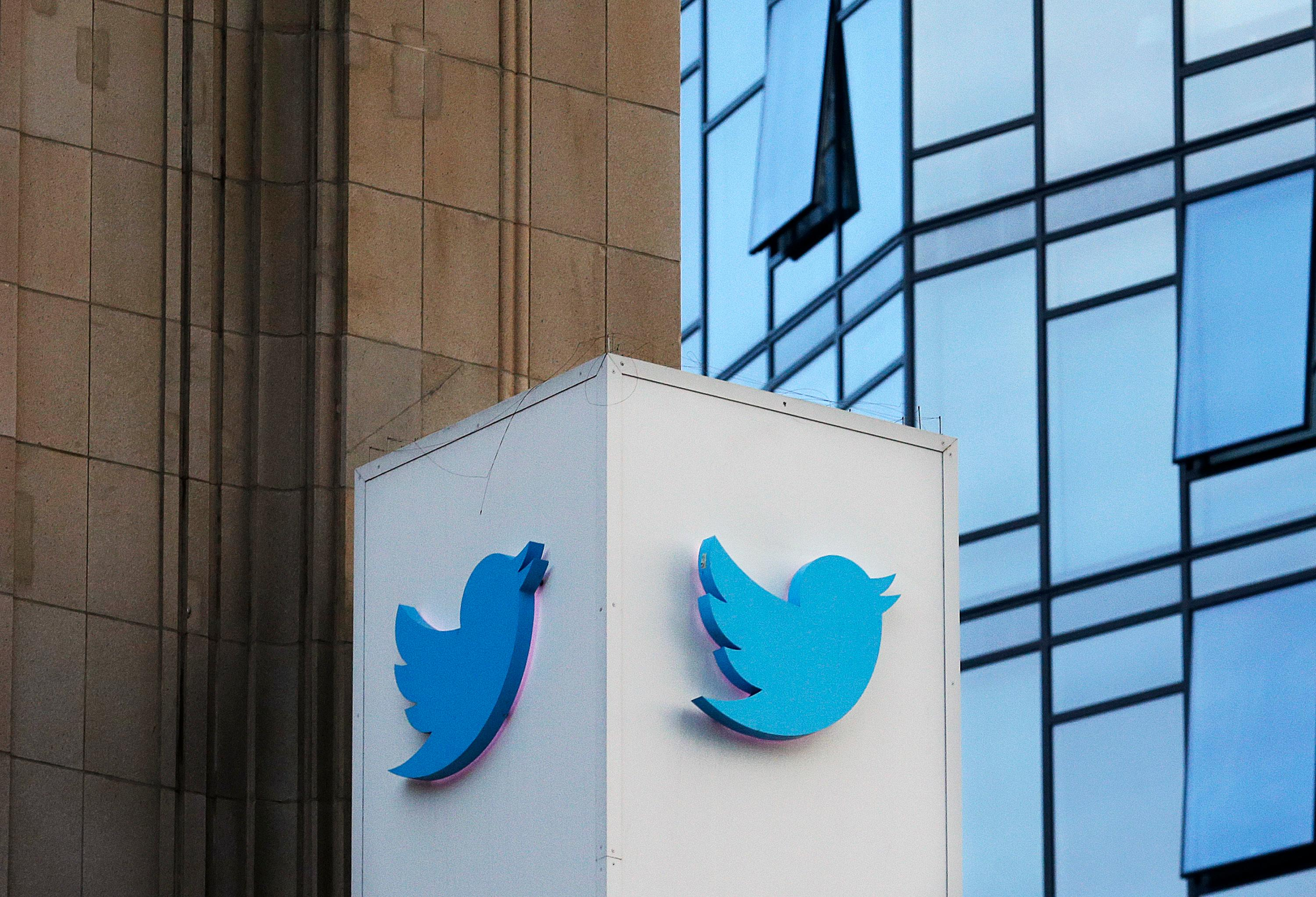 FILE - This Oct. 26, 2016 file photo shows a Twitter sign outside of the company's headquarters in San Francisco. (AP Photo/Jeff Chiu, File)