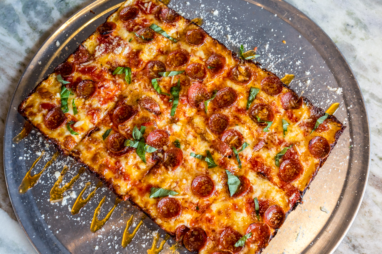 Detroit-style Pepperoni and Hot Honey Pizza: tomato sauce, mozzarella, pepperoni, basil, Mike's Hot Honey, and parmigiano reggiano / Image: Catherine Viox // Published: 7.12.19