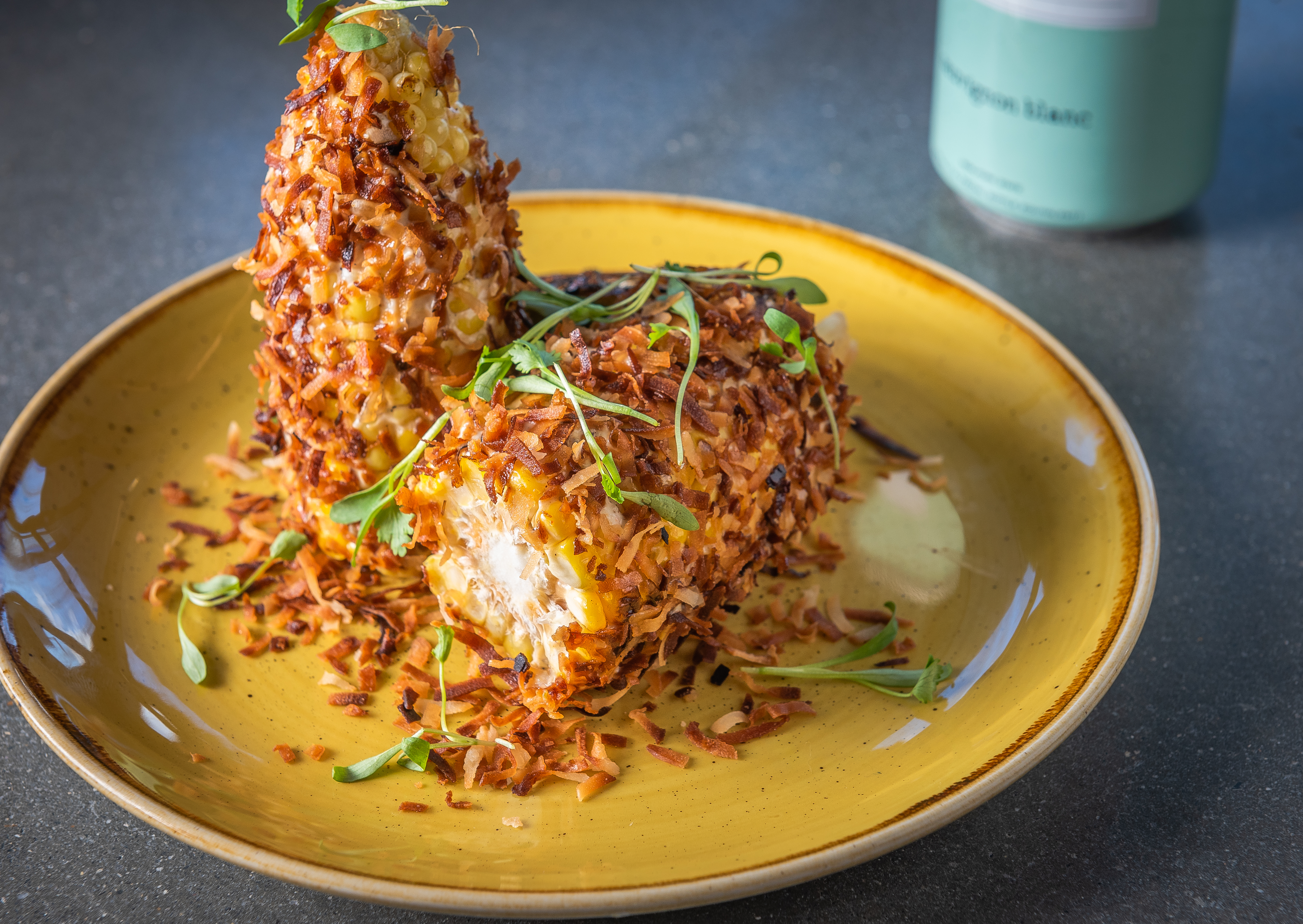 Roasted street corn at Vim & Victor.{ }(Image: Rey Lopez)