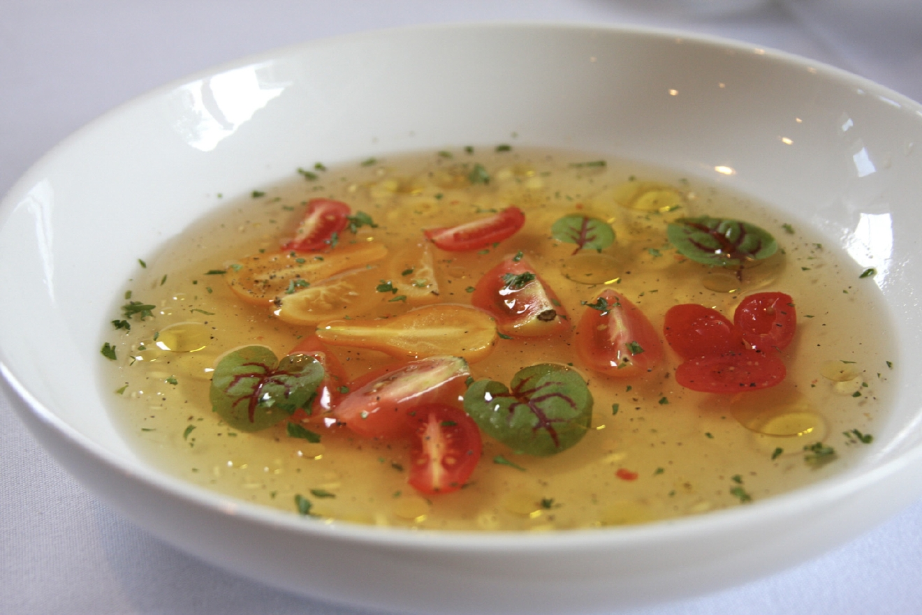 Mark's Tomato Consommé:  Kentucky Heirloom tomato consommé, Carriage House cherry tomatoes and basil, extra virgin olive oil, cracked pepper, and Waterfield's red vein sorrel / Image: Molly Paz