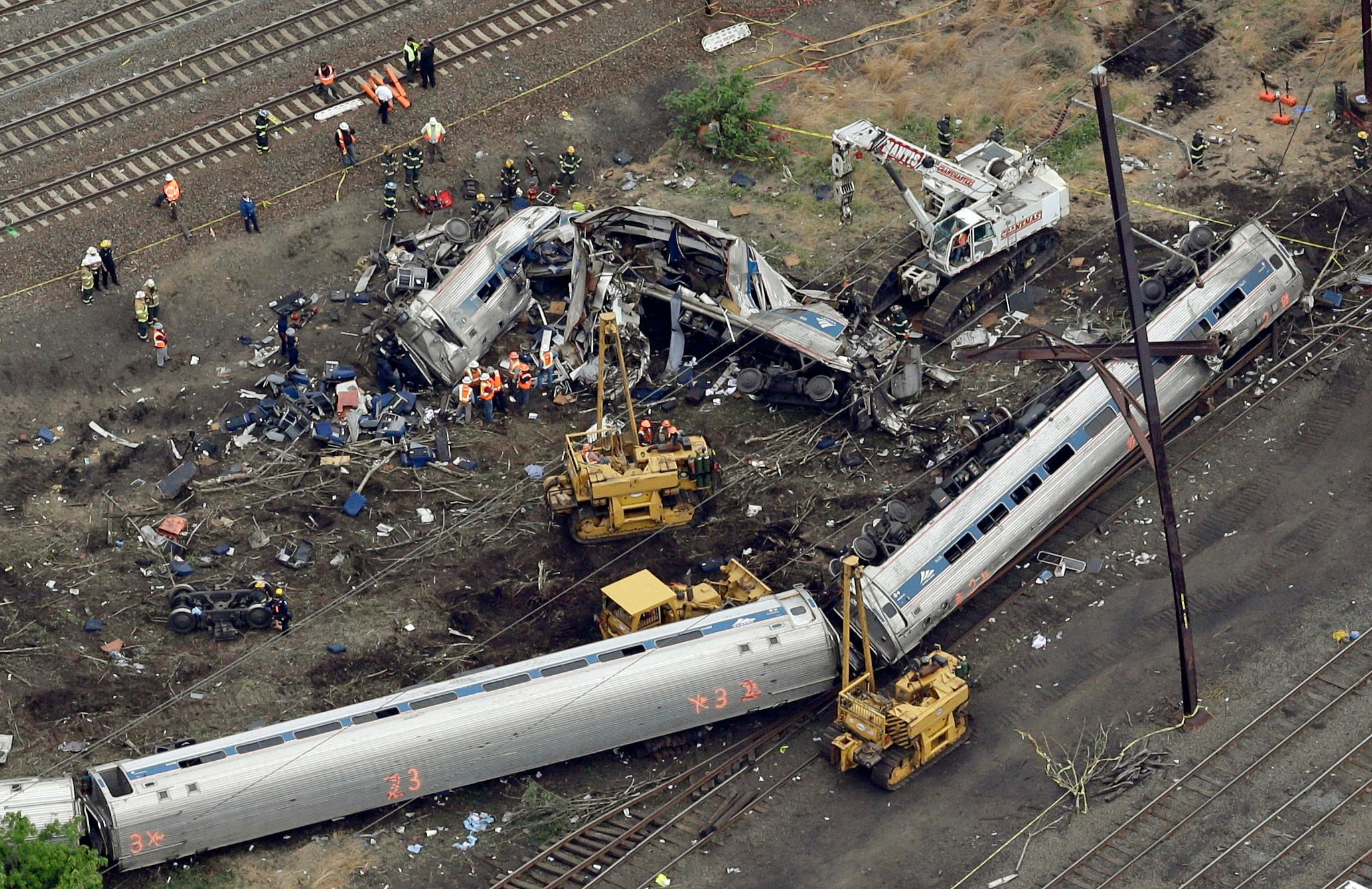 FILE - In this May 13, 2015, file photo, emergency personnel work at the scene of a derailment in Philadelphia of an Amtrak train headed to New York. (AP Photo/Patrick Semansky, File)<p></p>
