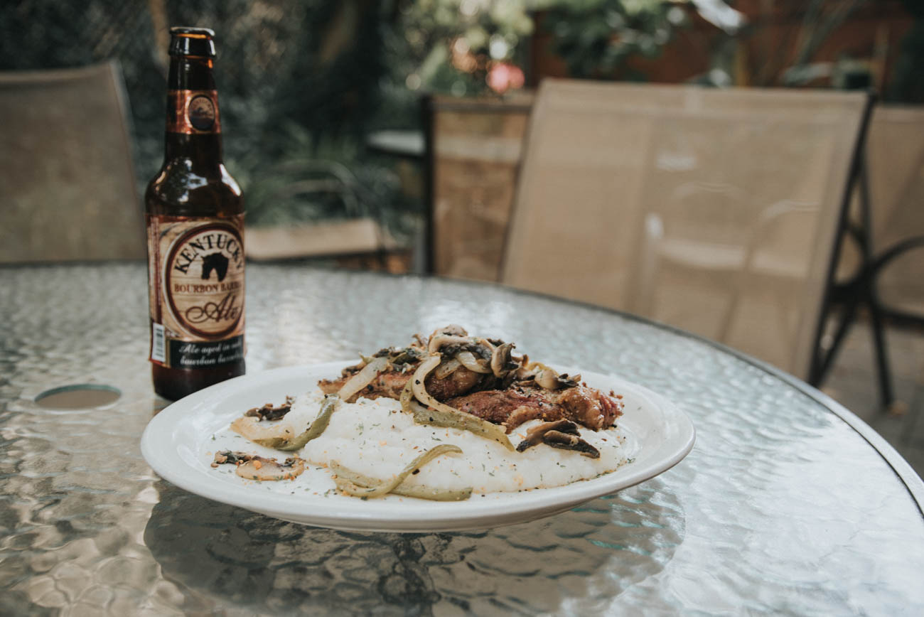 Steak with garlic mashed potatoes, grilled onions, peppers and mushrooms with a Kentucky Bourbon Barrel Ale / Image: Brianna Long // Published: 9.2.17