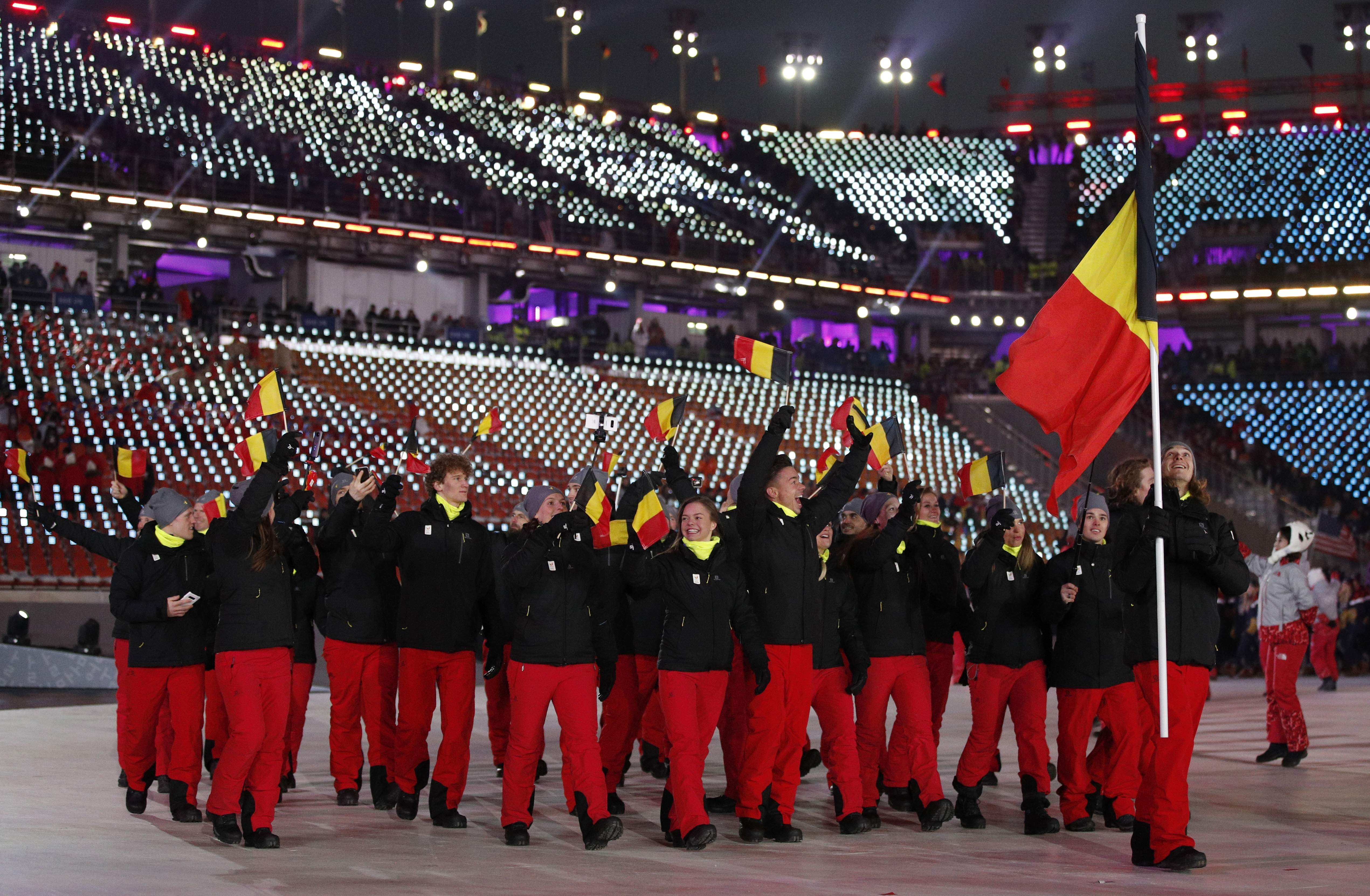 Seppe Smits carries the flag of Belgium during the opening ceremony of the 2018 Winter Olympics in Pyeongchang, South Korea, Friday, Feb. 9, 2018. (AP Photo/Jae C. Hong)