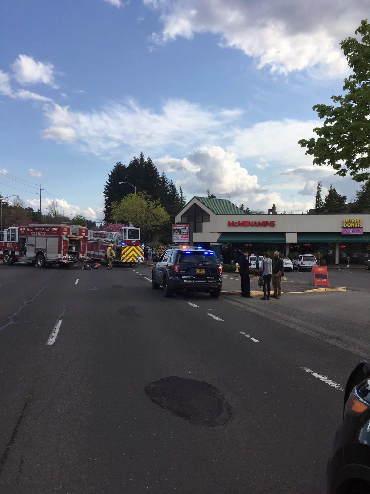 Emergency workers with Tualatin Valley Fire & Rescue respond Tuesday, April 18, 2017 to a crash where a driver of a car hit a bicyclist near Southwest Murray and Allen. (Photo: Beaverton Police Department)