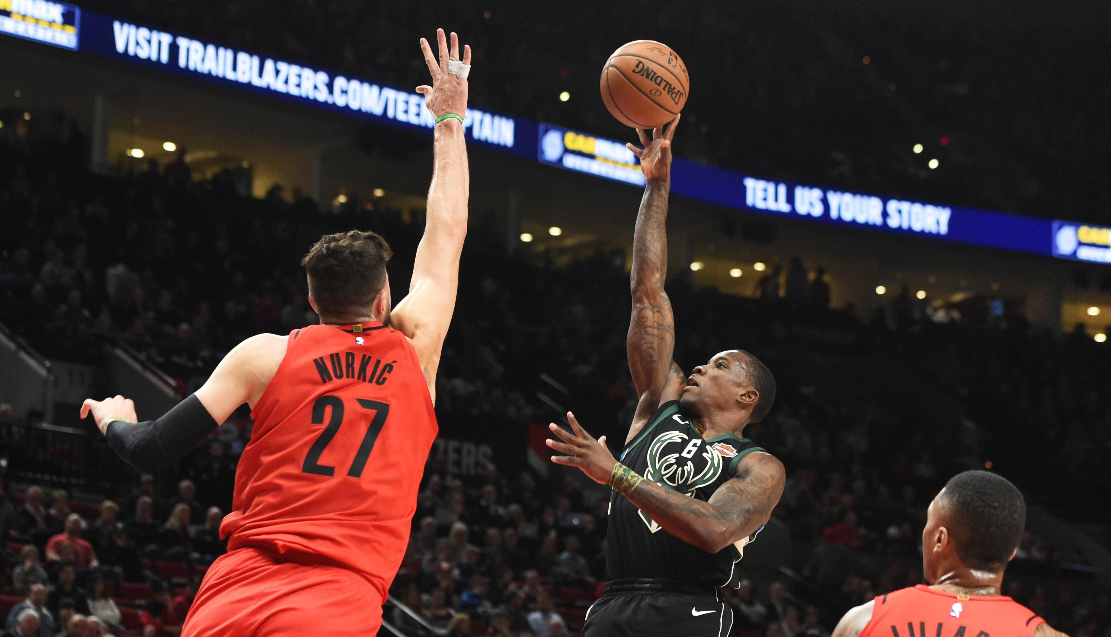 Milwaukee Bucks guard Eric Bledsoe shoots over Portland Trail Blazers center Jusuf Nurkic during the first quarter of an NBA basketball game in Portland, Ore., Thursday, Nov. 30, 2017. (AP Photo/Steve Dykes)