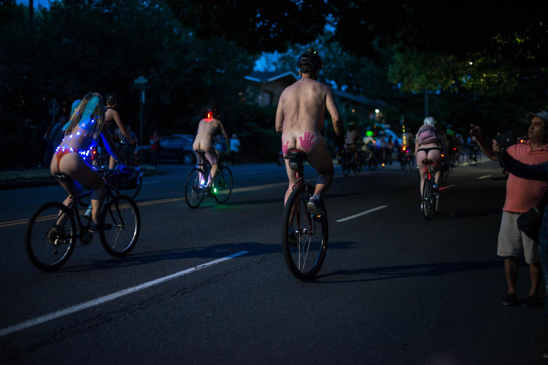 Bare bicyclists filled the streets of Portland on Saturday for the 15th annual World Naked Bike Ride. The ride highlights global oil dependency and the vulnerability of cyclists on the roads. The group gathered in Southeast Portland's Laurelhurst Park before riding through the streets, crossing the Burnside Bridge. (KATU photo taken 6-29-2019 by Tristan Fortsch)