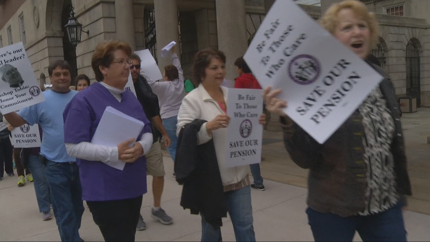 Retired nurses from St. Joseph's Hospital and Fatima Hospital protest outside Providence Superior Court, Wednesday, Oct. 11, 2017. (WJAR)