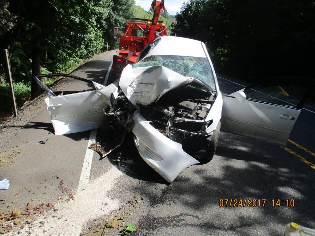A Eugene woman pulled from the wreckage of a car died at the scene after a crash in Lane County, Oregon State Police said. (Oregon State Police photo)