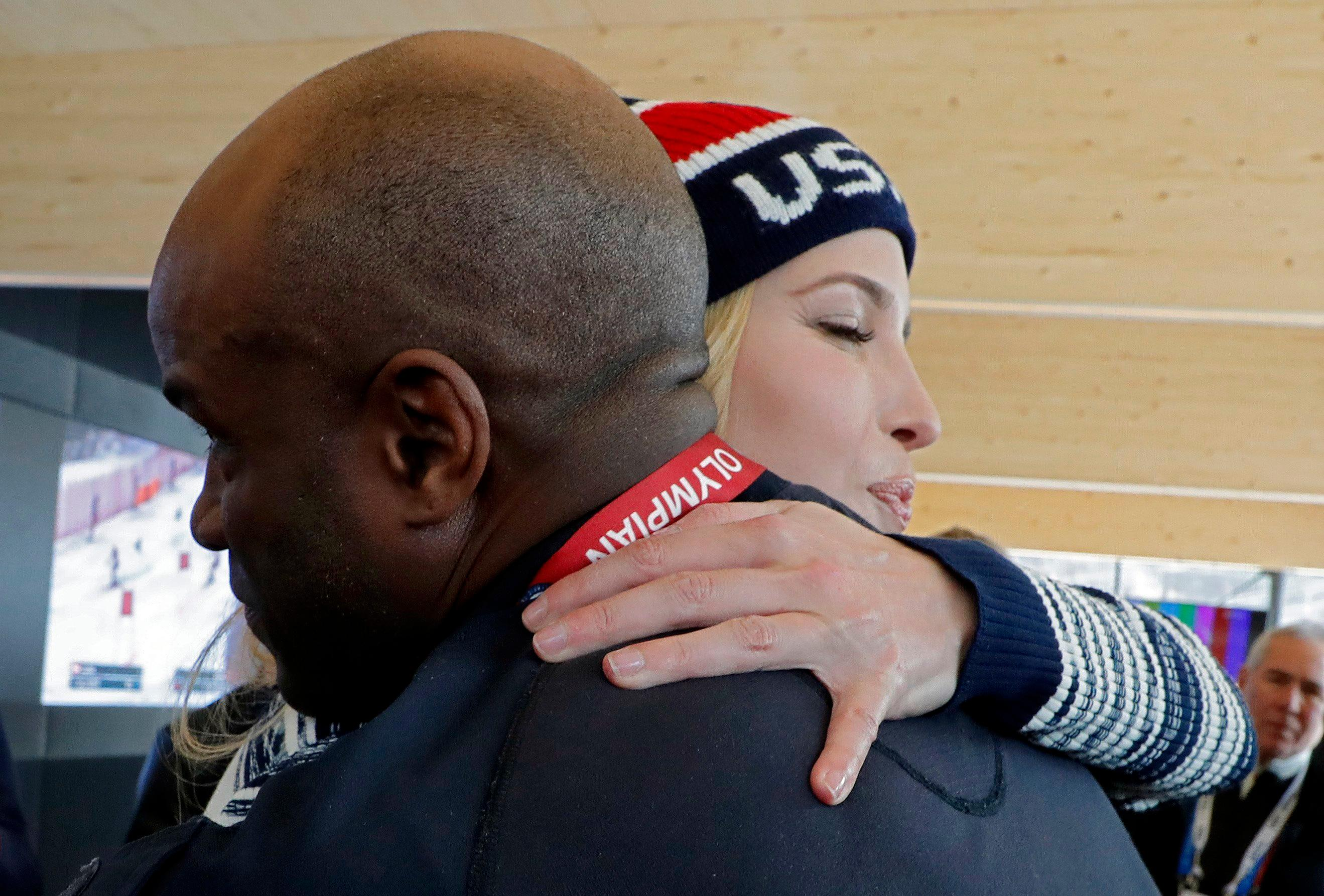 Ivanka Trump, daughter of U.S. President Donald Trump and senior White House adviser, hugs former U.S. bobsledder Garrett Hines while visiting USA House during the 2018 Winter Olympics on Saturday, Feb. 24, 2018, in Pyeongchang, South Korea. (Eric Gaillard/Pool Photo via AP)