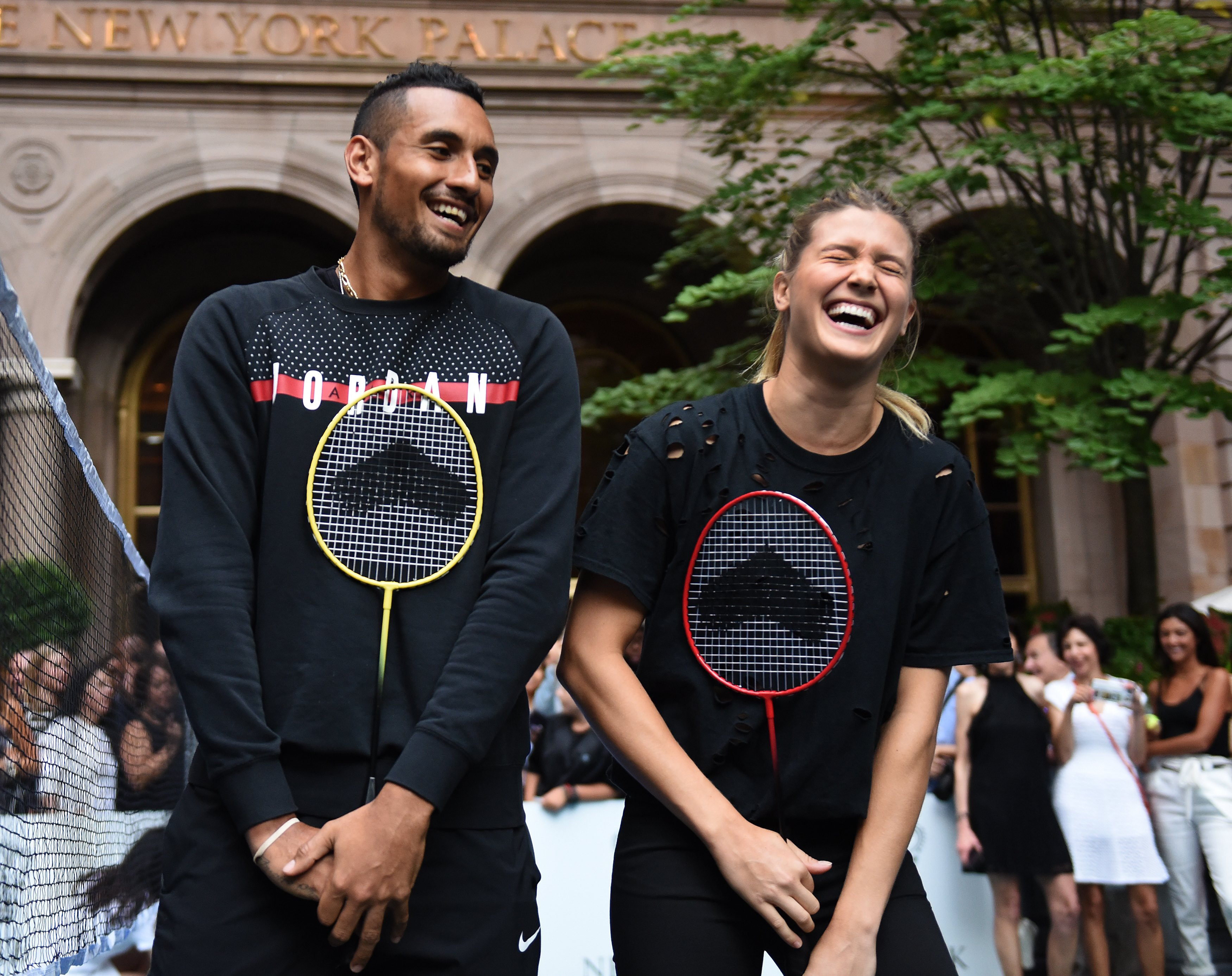 Tennis players Genie Bouchard of Canada (R) stands with Nick Kyrgioas of Australia (L) following their match in the Lotte New York Palace Invitational Badminton Tournament at the Lotte New York Palace in New York August 24, 2017. / AFP PHOTO / TIMOTHY A. CLARY        (Photo credit should read TIMOTHY A. CLARY/AFP/Getty Images)