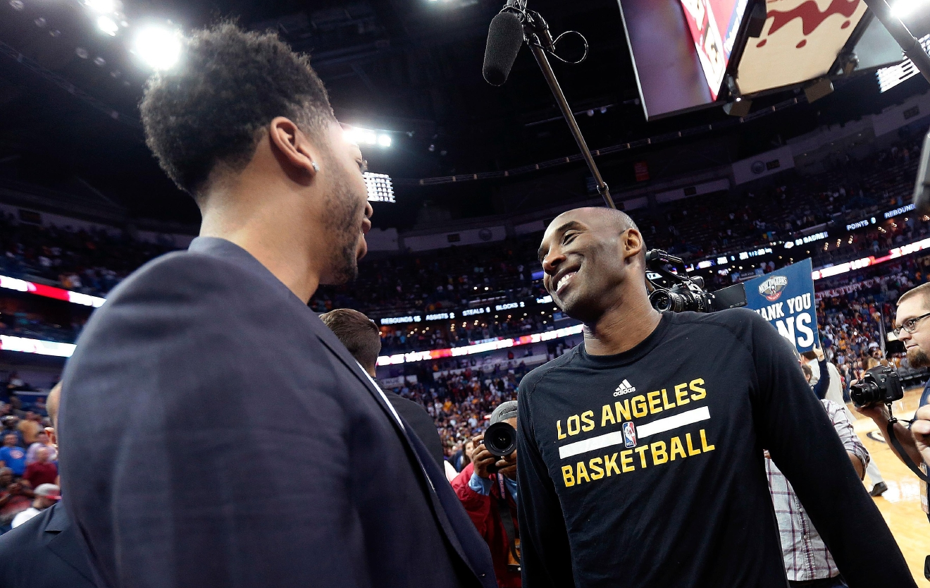 Los Angeles Lakers forward Kobe Bryant, right, smiles with New Orleans Pelicans forward Anthony Davis after an NBA basketball game in New Orleans, Friday, April 8, 2016. The Pelicans won 110-102. The game was Bryant's last in New Orleans since he will be retiring at the end of the season. (AP Photo/Gerald Herbert)