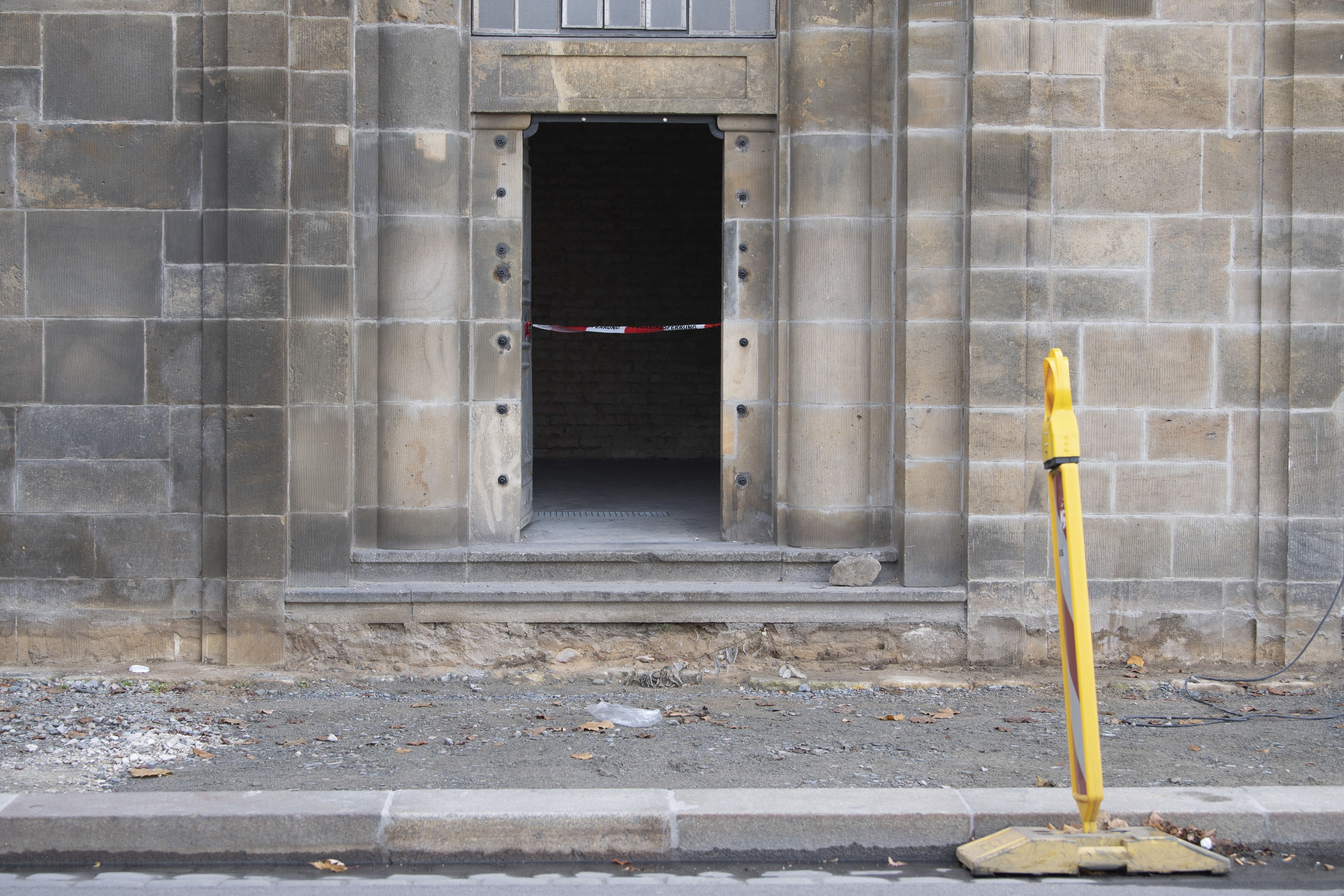 A caution tape is fixed at the entrance to catacombs under the August Bridge, where a fire destroyed the power supply for the State Art Collection with the Green Vault in Dresden, Germany, Monday, Nov. 25, 2019. Authorities in Germany say thieves have carried out a brazen heist at Dresden's Green Vault, one of the world's oldest museum containing priceless treasures from around the world. (Sebastian Kahnert/dpa via AP)