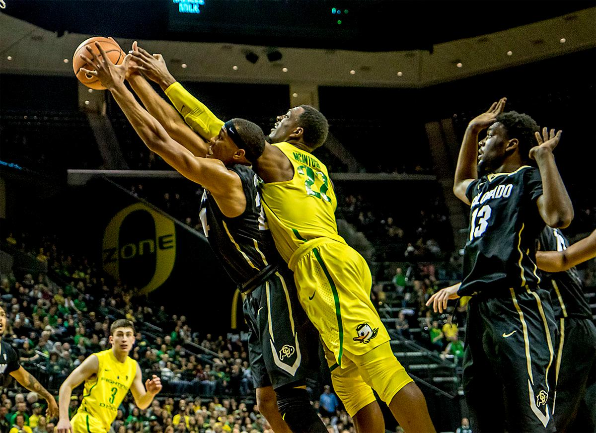 The Duck's MiKyle McIntosh (#22) dives to catch the rebound. The Oregon Ducks defeated the Colorado Buffaloes 77-62 at Matthew Knight Arena on Sunday. Troy Brown had a season-high score of 21 points, Elijah Brown added 17, while Kenny Wooten and Payton Pritchard added 13 and 12 respectively. Oregon is now 1-1 in conference play. The Ducks next face off against the Oregon State Beavers in Corvallis on Friday, January 5th. Photo by August Frank, Oregon News Lab