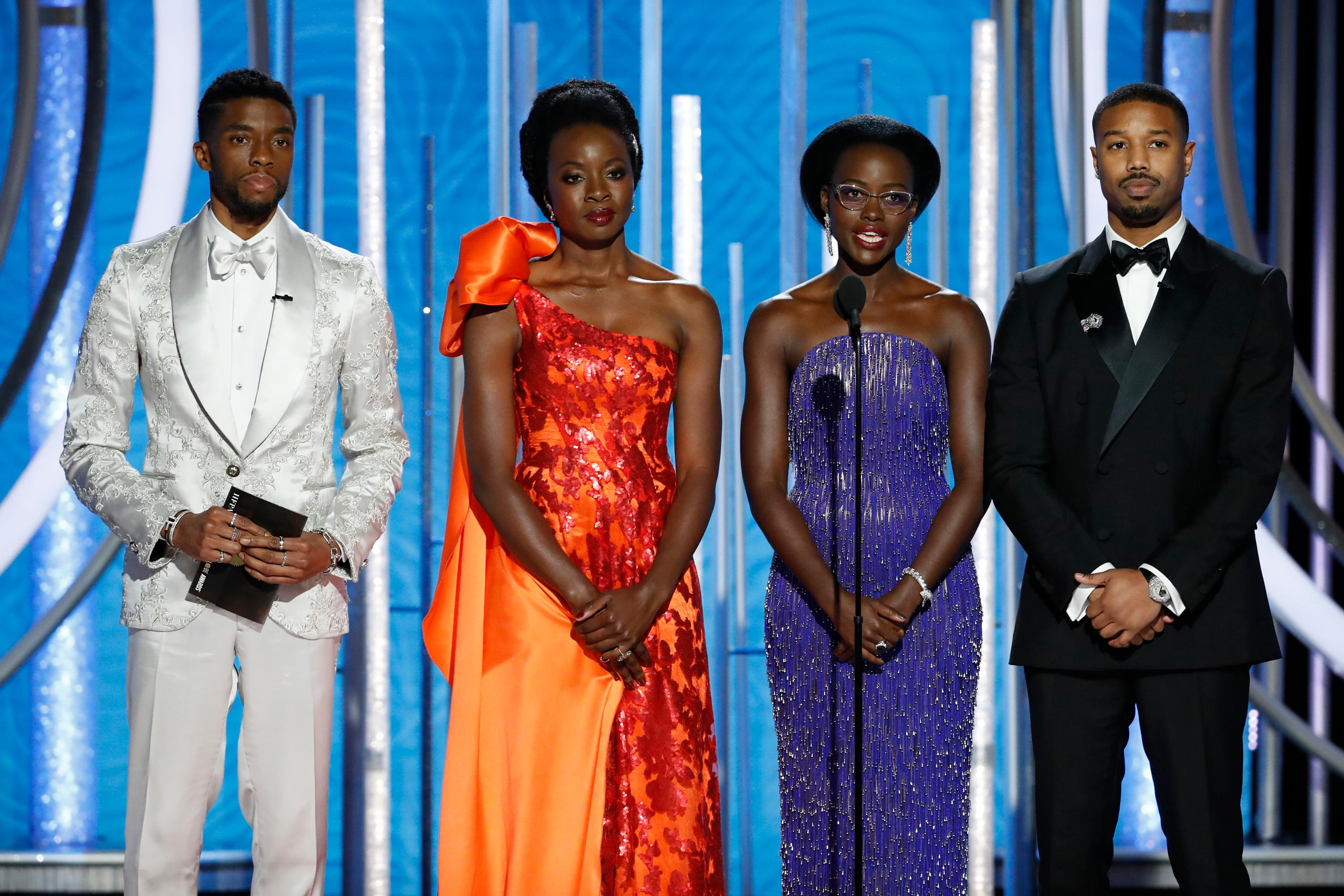 "This image released by NBC shows the cast of ""Black Panther,"" from left, Chadwick Boseman, Danai Gurira, Lupita Nyong'o and Michael B. Jordan presenting the award for best animated feature during the 76th Annual Golden Globe Awards at the Beverly Hilton Hotel, Sunday, Jan. 6, 2019 in Beverly Hills, Calif. (Paul Drinkwater/NBC via AP)"