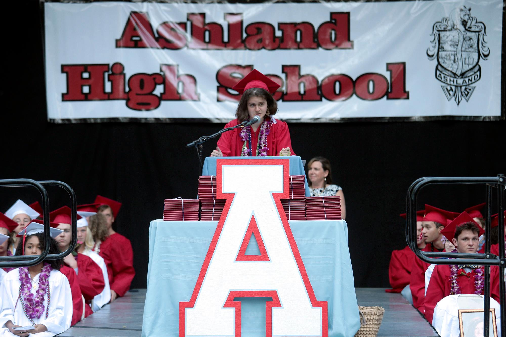 ASB Vice President Emily Belcastro introducing the Keynote Speaker, Bill Rauch, during the Ashland High Class of 2018 Commencement Ceremony at Lithia Park.   [ / PHOTO BY:  LARRY STAUTH JR]