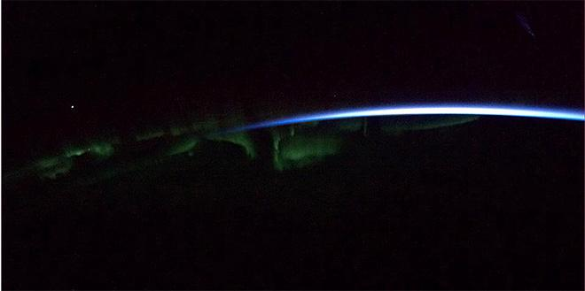 Aurora dances above a ribbon of dawn. (Photo & Caption: Chris Hadfield/NASA)