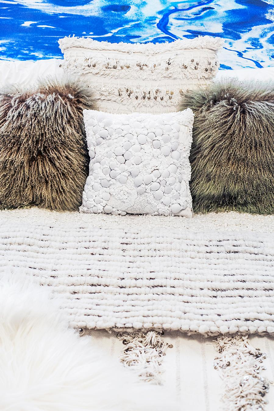 Add dimension and texture to the room with fun throw pillows and blankets.(Image: Ashley Hafstead)