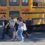 Parents film video showing kids crossing behind school bus