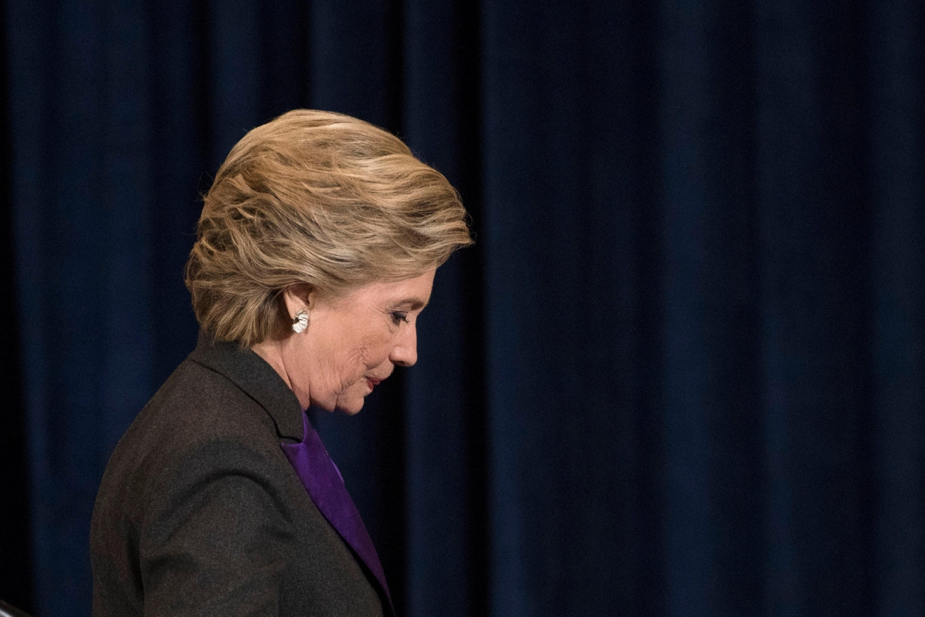 Democratic presidential candidate Hillary Clinton walks off the stage after speaking in New York, Wednesday, Nov. 9, 2016. (AP Photo/Matt Rourke)