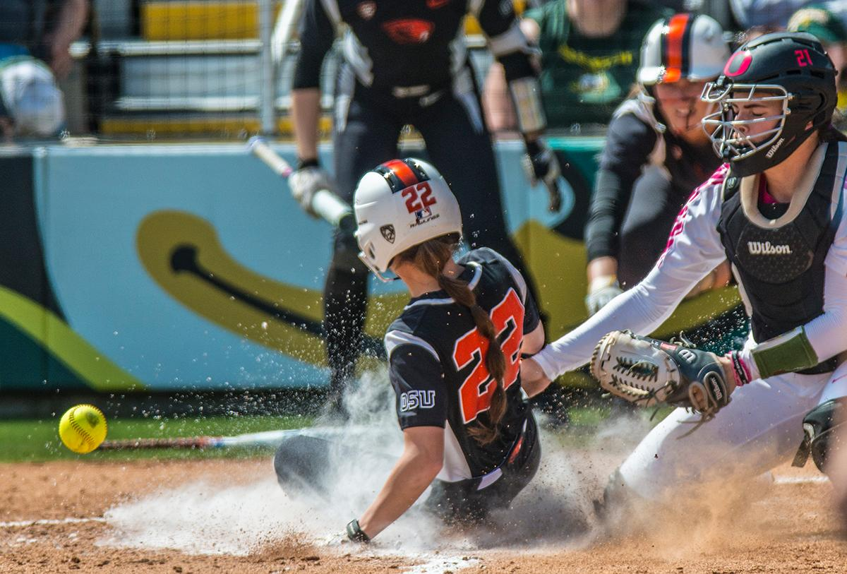 Oregon State Beavers Riley Gregoire (#22) slides into home base. The Oregon Ducks defeated the Oregon State Beavers 7-2 in game two of the three-game Civil War series at Jane Sanders Stadium on Saturday. The final game of the series will be on Sunday at 3:00 p.m. at Jane Sanders Stadium. Photo by Rhianna Gelhart, Oregon News Lab