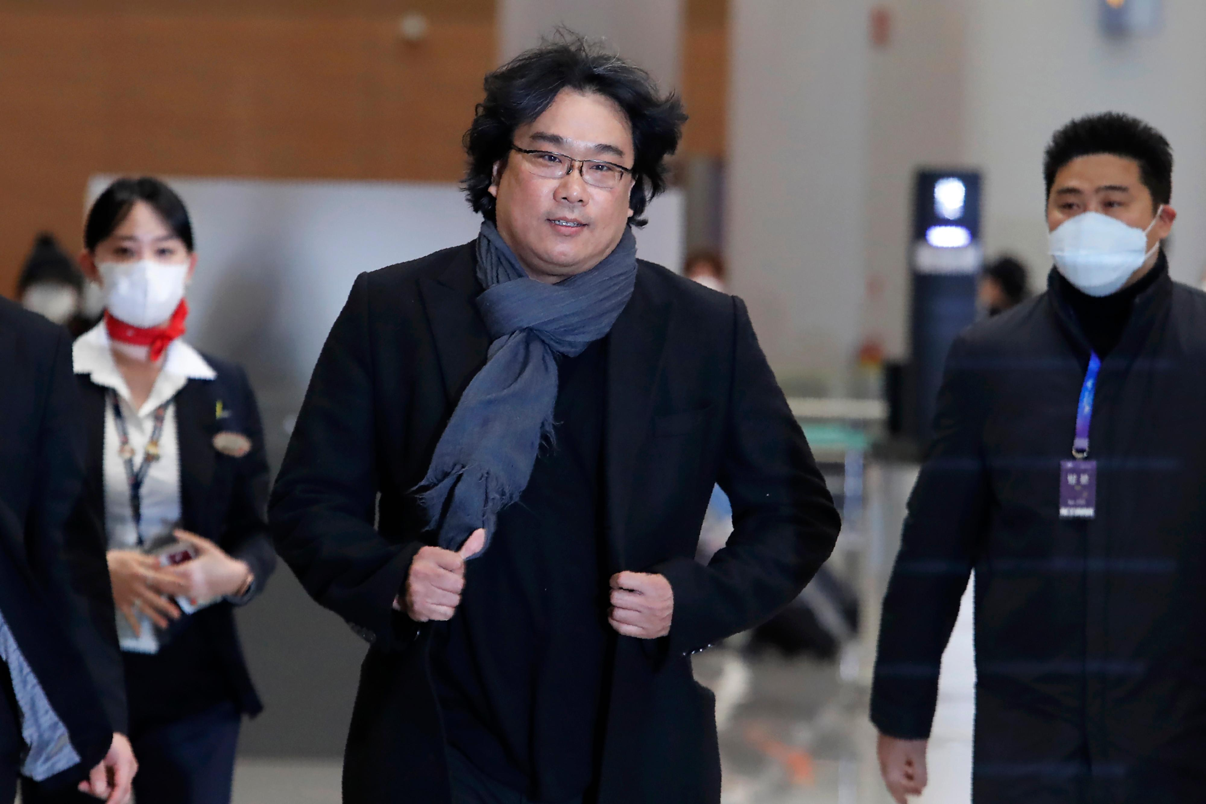 "South Korean director Bong Joon-ho arrives at the Incheon International Airport in Incheon, South Korea, Sunday, Feb. 16, 2020. South Koreans are reveling in writer-director Bong's dark comic thriller, ""Parasite,"" which won this year's Academy Awards for best film and best international feature. The movie itself, however, doesn't put the country in a particularly positive light. (AP Photo/Ahn Young-joon)"