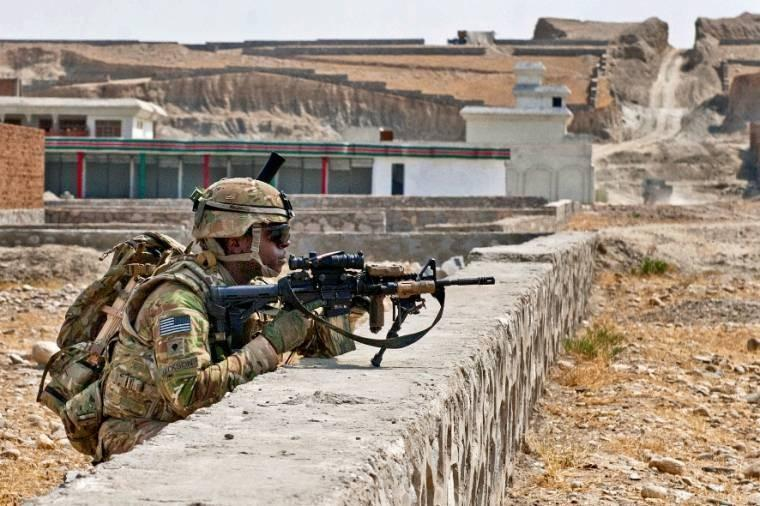 U.S. Army Spc. Kevin Jackson provides security during a reconnaissance mission in a village south of Forward Operating Base Fenty in Afghanistan's Nangarhar province. Jackson is assigned to the 1st Cavalry Division's 4th Squadron.