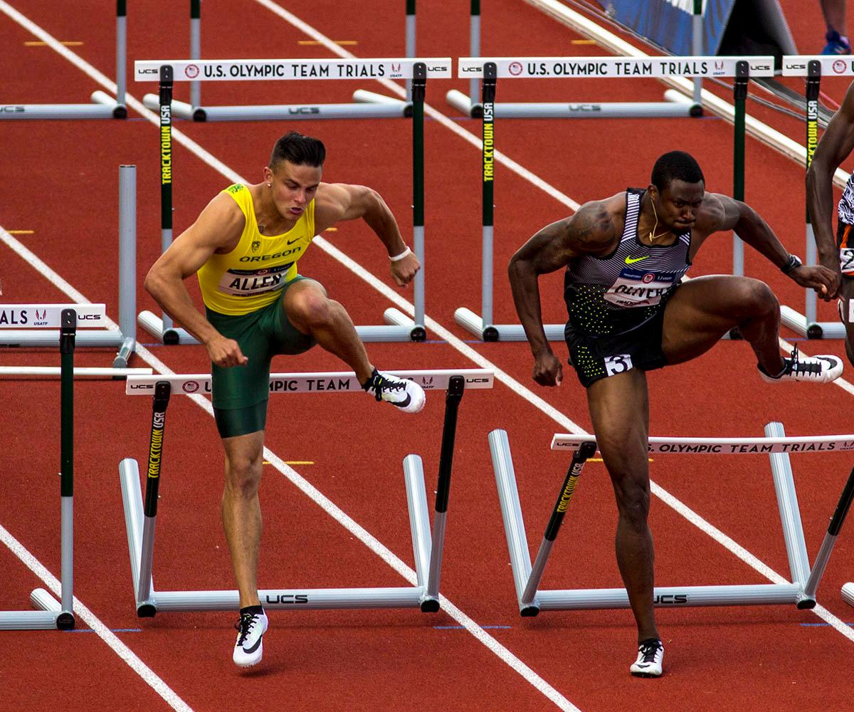 Oregon�s Devon Allen, left, and Nike�s David Oliver, right, leap over a hurdle in the Men�s 110m Hurdles semi-finals. Allen finished the race with a time of 13.40 and Oliver finished with a time of 13.46. Allen went on to win in the finals. Day nine of the U.S. Olympic Track and Field Trials took place Saturday at Hayward Field in Eugene, Ore. Events continue through July 10. (Photo by Amanda Butt)
