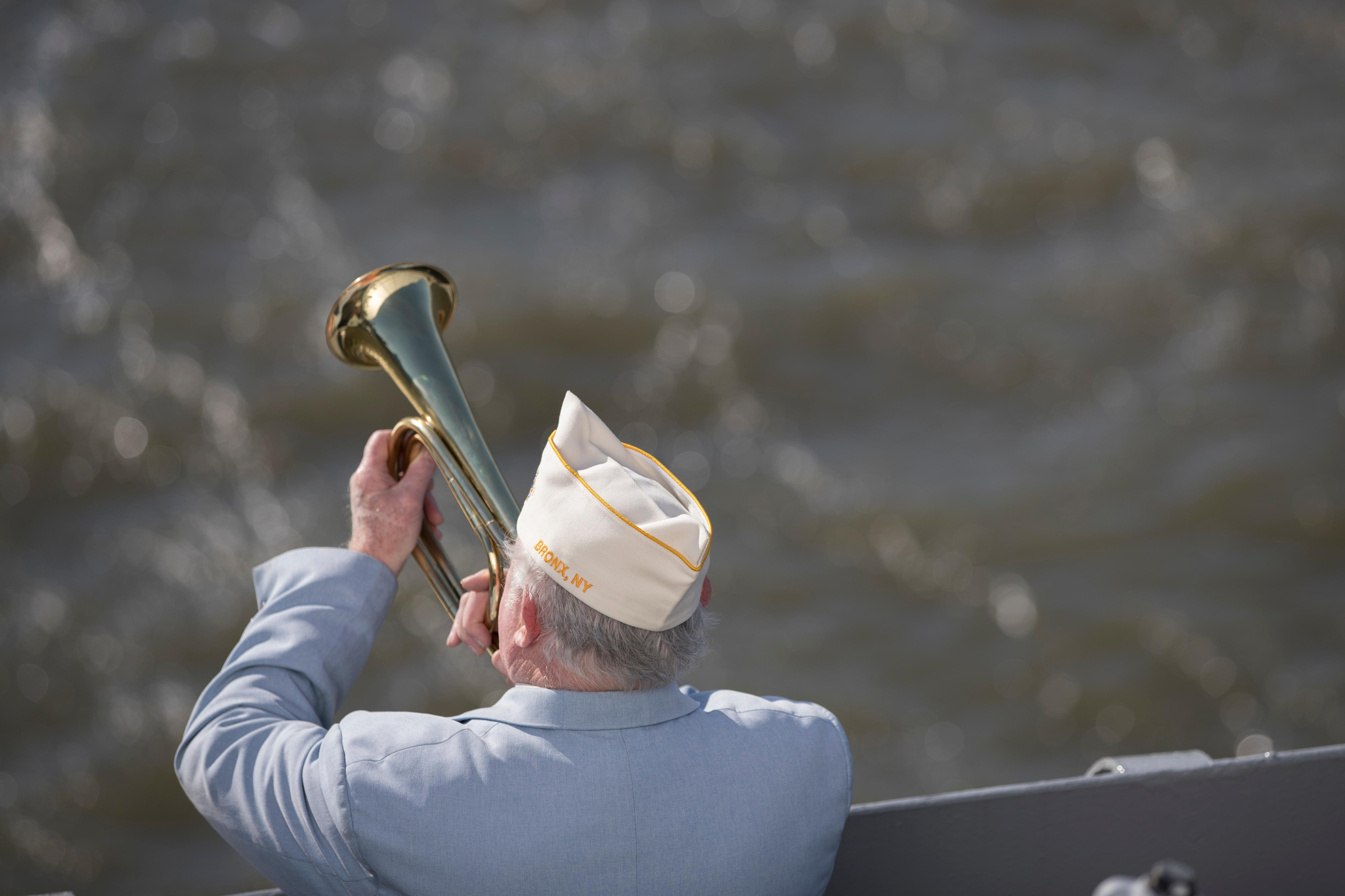 Vietnam veteran Jim Mullarkey plays taps on his bugle during a ceremony commemorating the 76th anniversary of the Dec. 7, 1941 Japanese attack on Pearl Harbor, Thursday, Dec. 7, 2017, on board the Intrepid Sea, Air & Space Museum in New York. (AP Photo/Mary Altaffer)